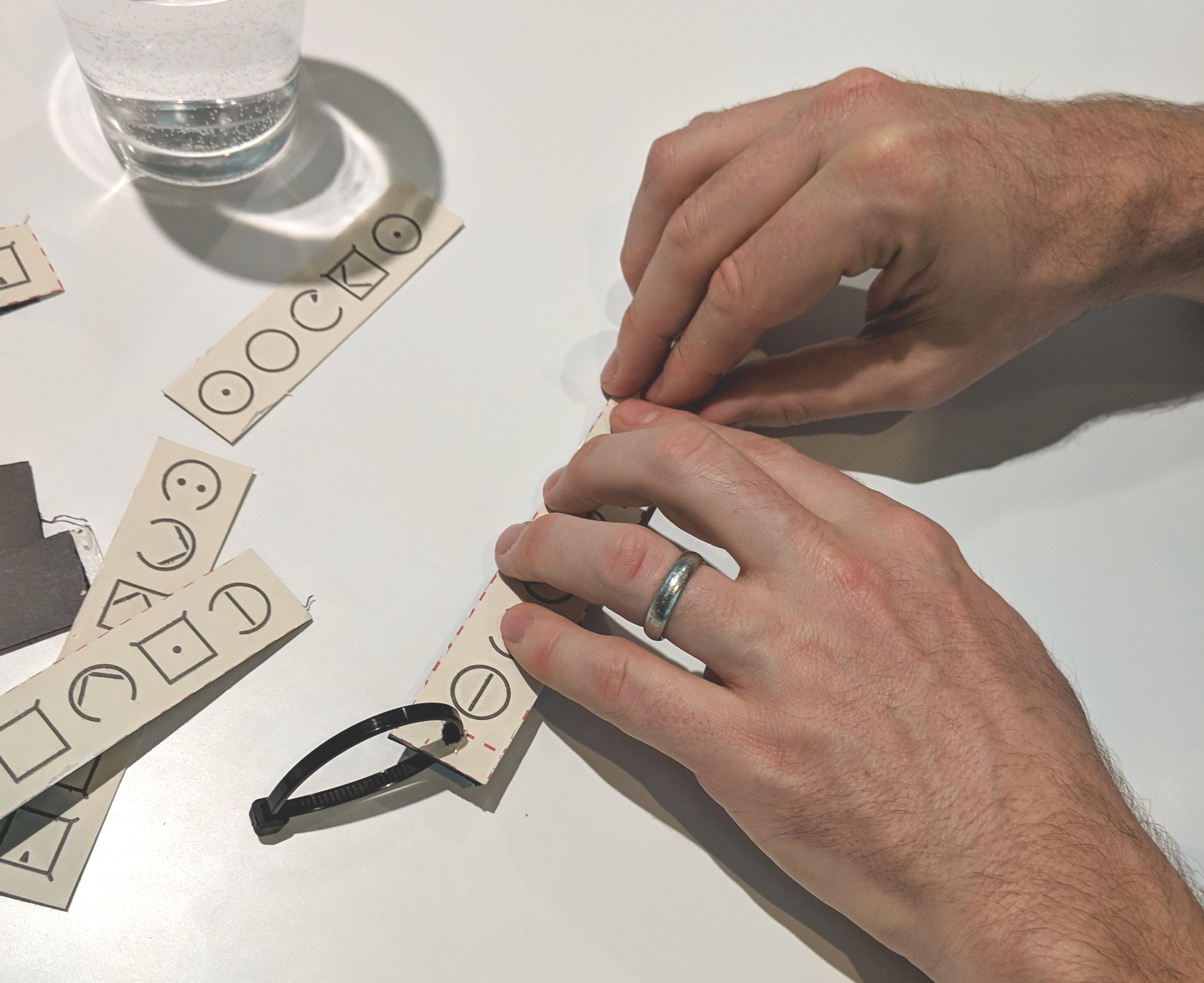 Testing ELIA Frame adhesive and hanging labels.