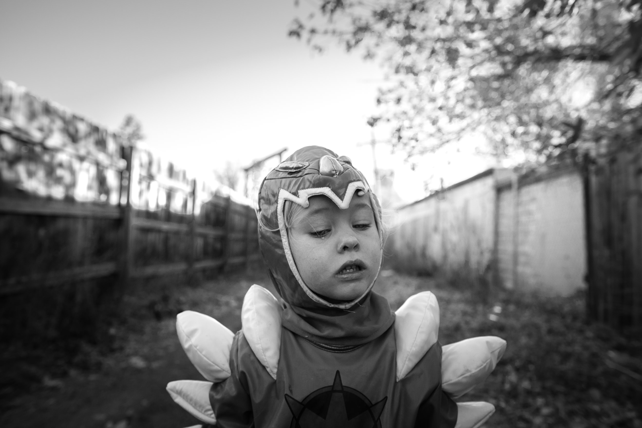 Molly Rees Photo - Black and White Documentary Childhood Photography - Portrait of girl in Power Rangers Halloween costume crying by M. Menschel