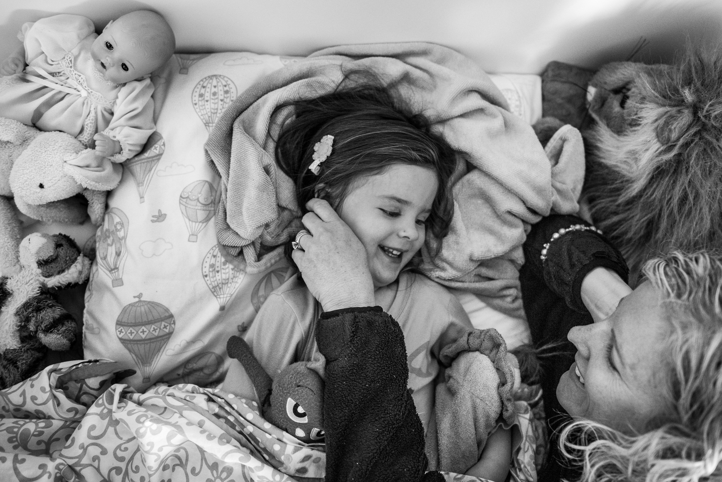 Molly Rees Photo - Black and White Documentary Family Photography - mother putting daughter to bed M. Menschel