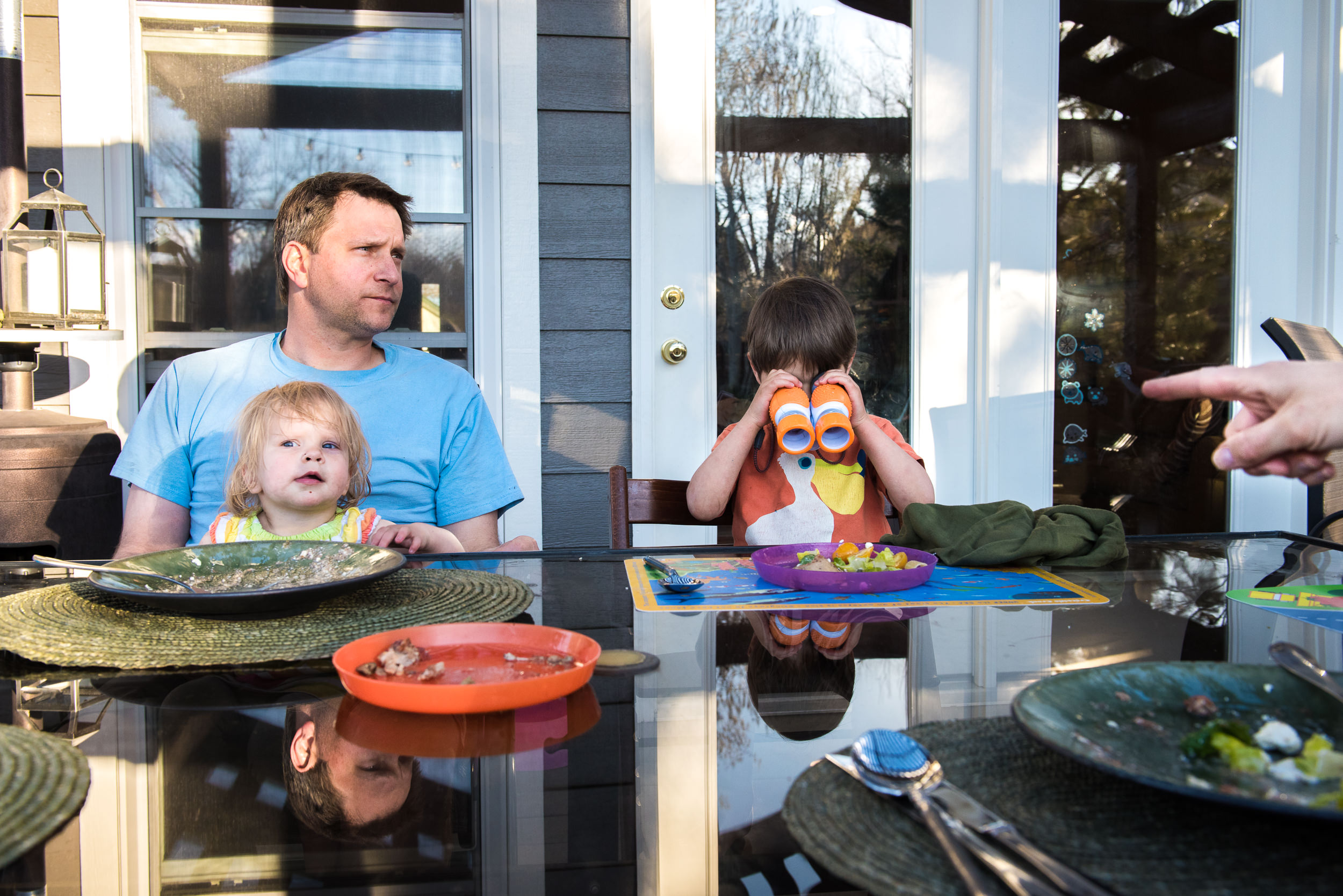 Documentary Family Photography in Denver, Colorado - dinner-time with binoculars