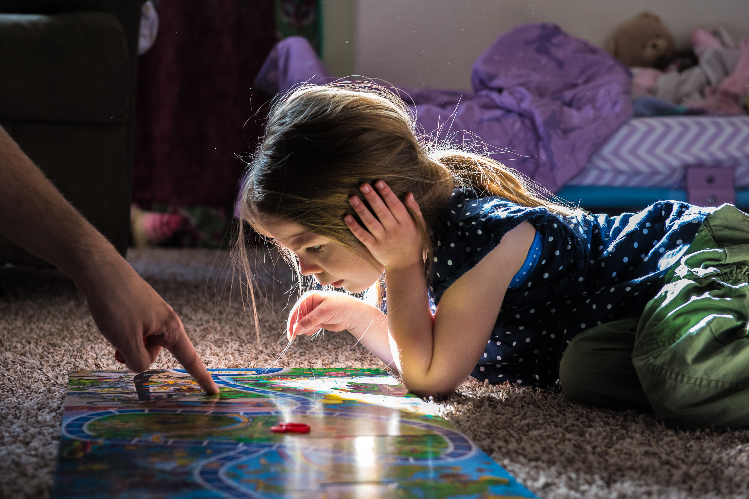 Documentary Family Photography in Denver, Colorado - girl playing board-game