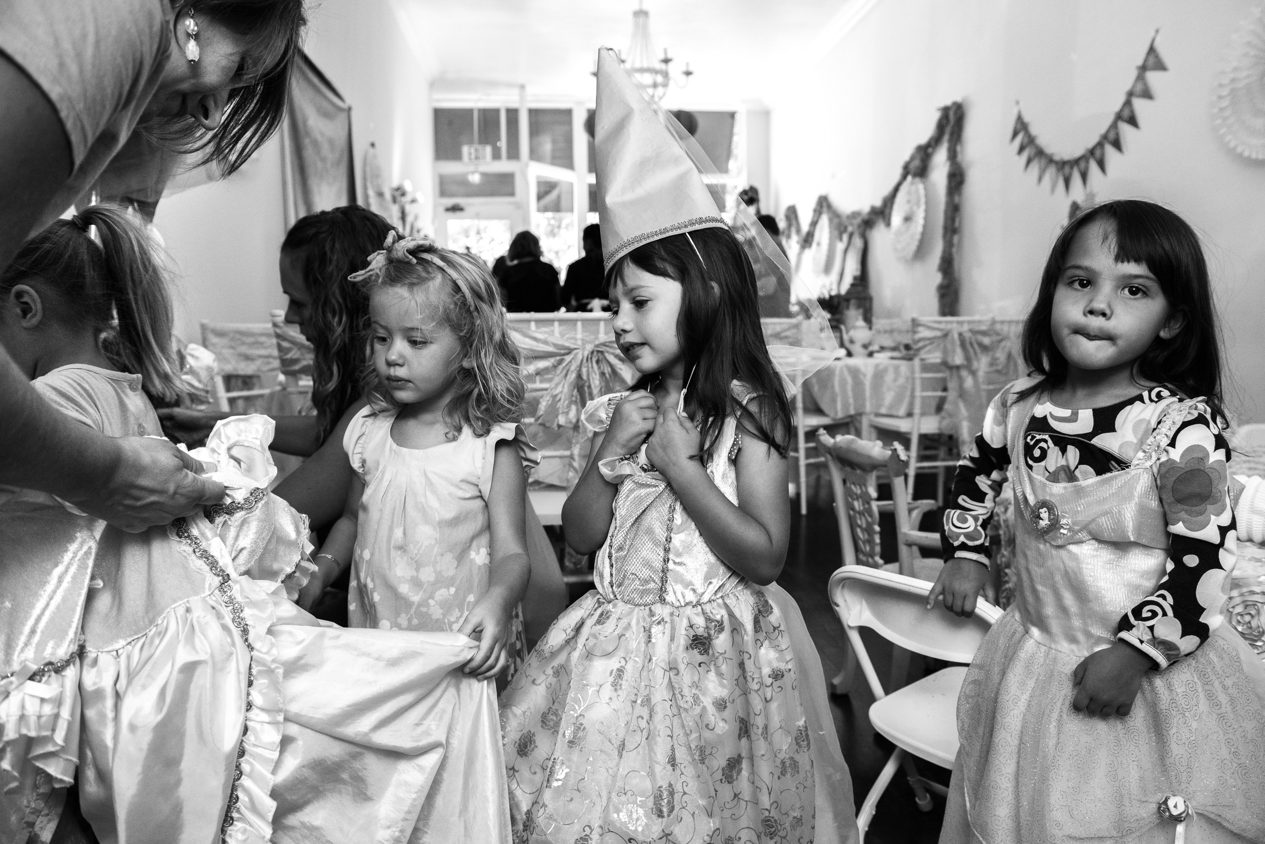 Molly Rees Photo - Black and White Documentary Family Photography in Denver, Colorado - birthday party girls in princess dresses at Wands and Wishes Occasions by M. Menschel