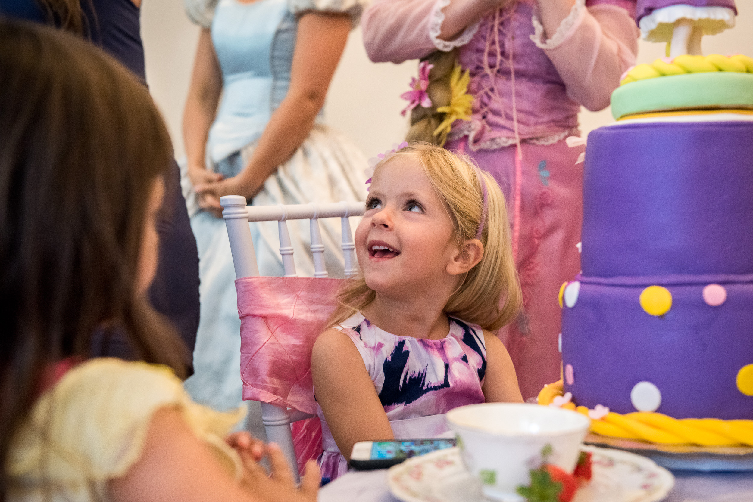 Documentary Family Photography in Denver, Colorado - birthday party girl princess tea party with cake at Wands and Wishes Occasions