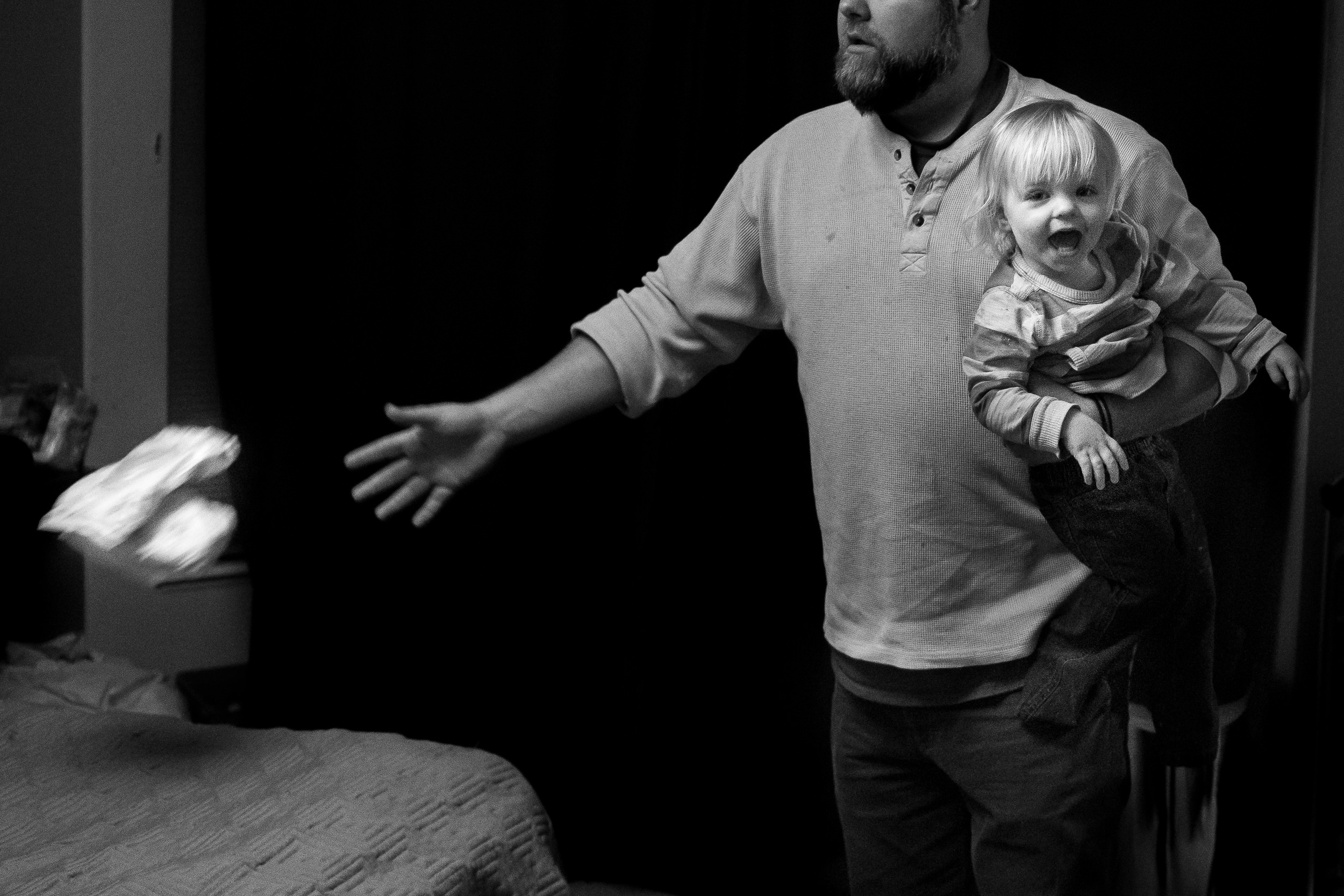 Black and White Documentary Family Photography in Denver, Colorado - dad diaper change