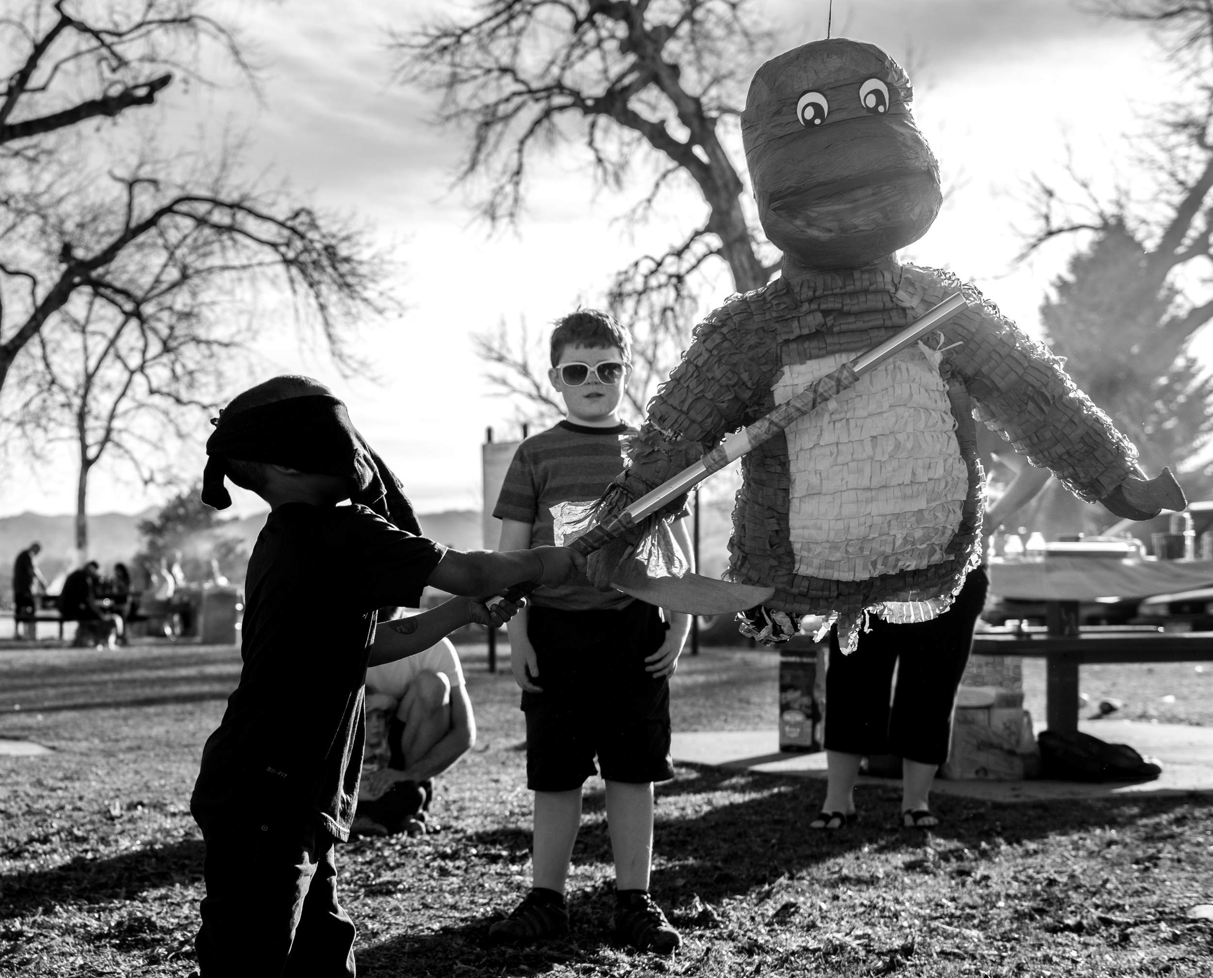 Blog - The Pen & Camera - Gratitude Journal, Inspirational, Writing, Denver, Colorado, Friendship -  Molly Rees Photo - Black and White Documentary Childhood Photography - boy with pinata at birthday party by M. Menschel