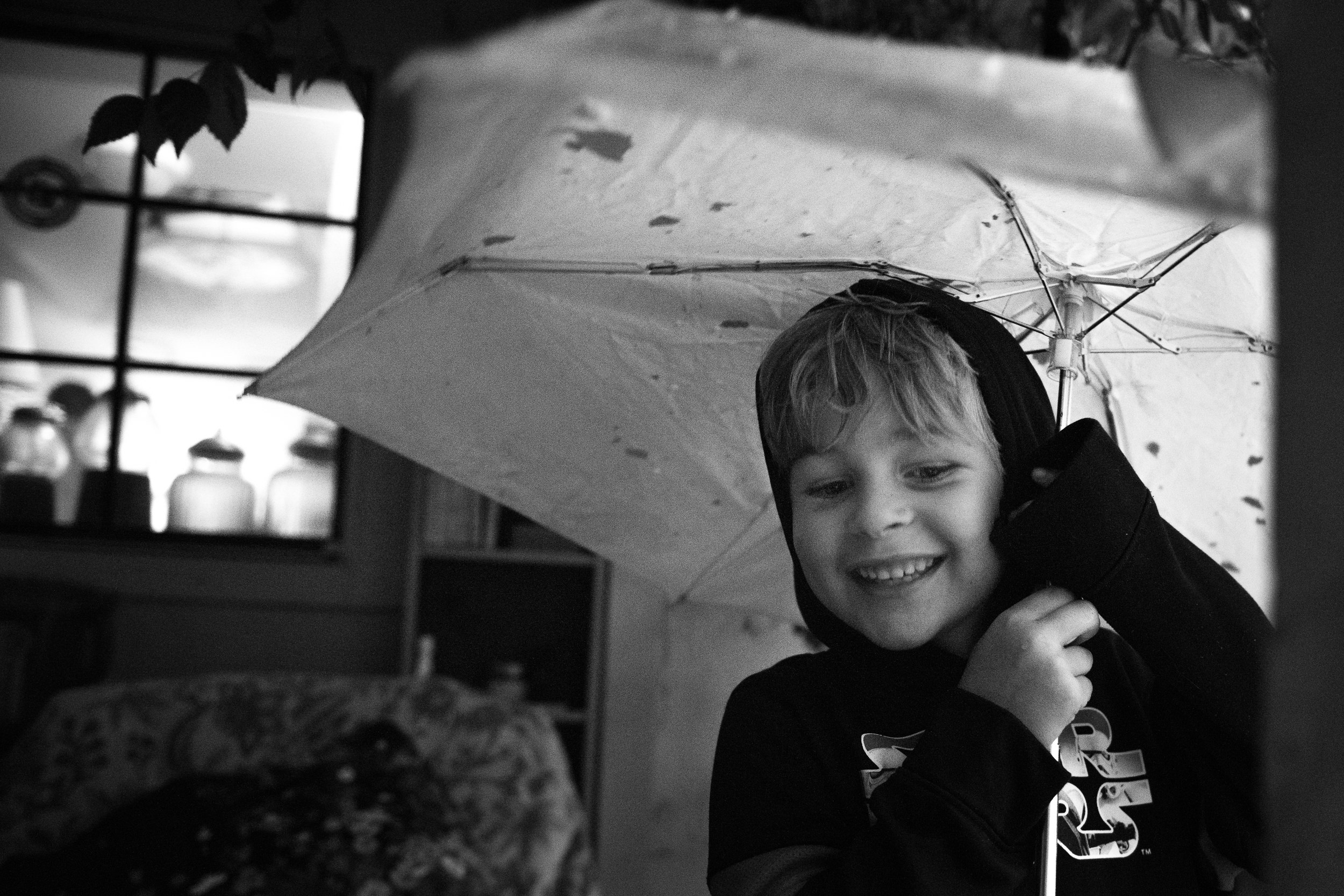 "Blog - The Pen & Camera - Poetry, Inspirational, Writing, Denver, Colorado -  Molly Rees Photo - Black and White Documentary Childhood Photography - boy with umbrella by M. Menschel ""Life will break you"" poem by Louise Erdrich"