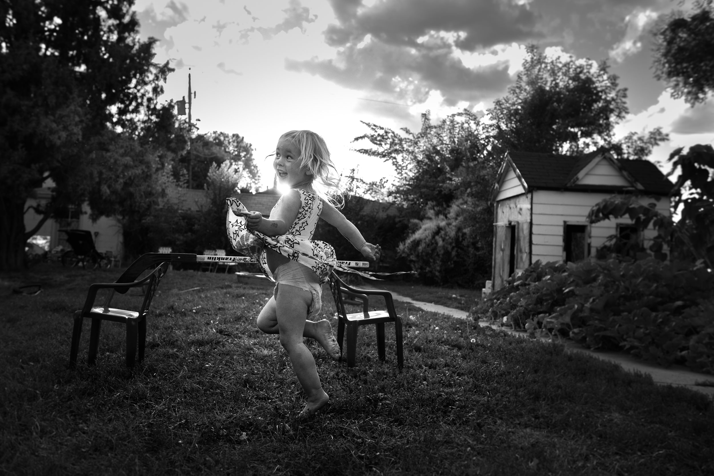 Blog - The Pen & Camera - Gratitude Journal, Inspirational, Motherhood, Writing, Denver, Colorado -  Molly Rees Photo - Black and White Documentary Childhood Photography - girl dancing in yard in summer by M. Menschel