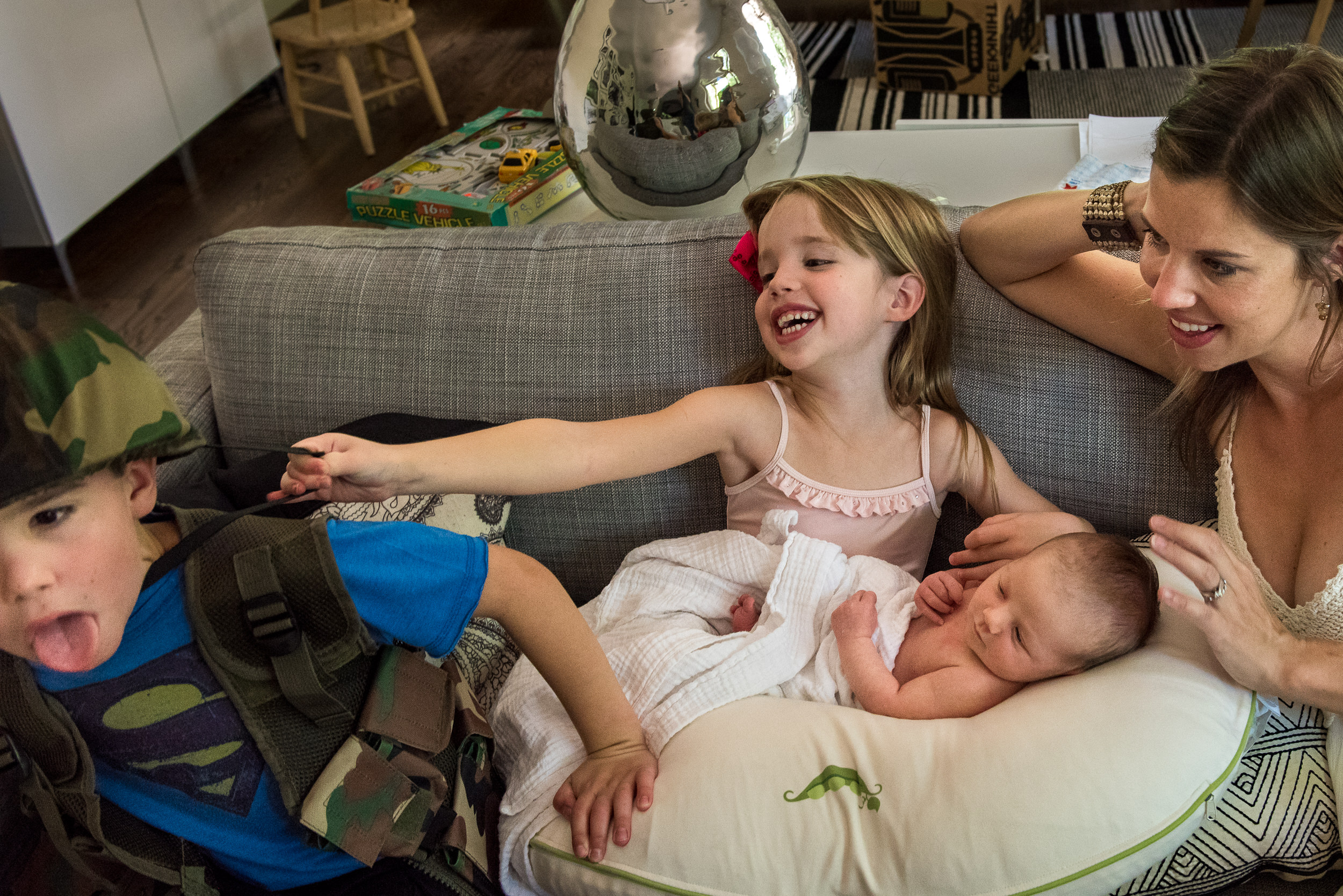 Documentary Newborn Photography in Denver, Colorado - brother and sister with new baby