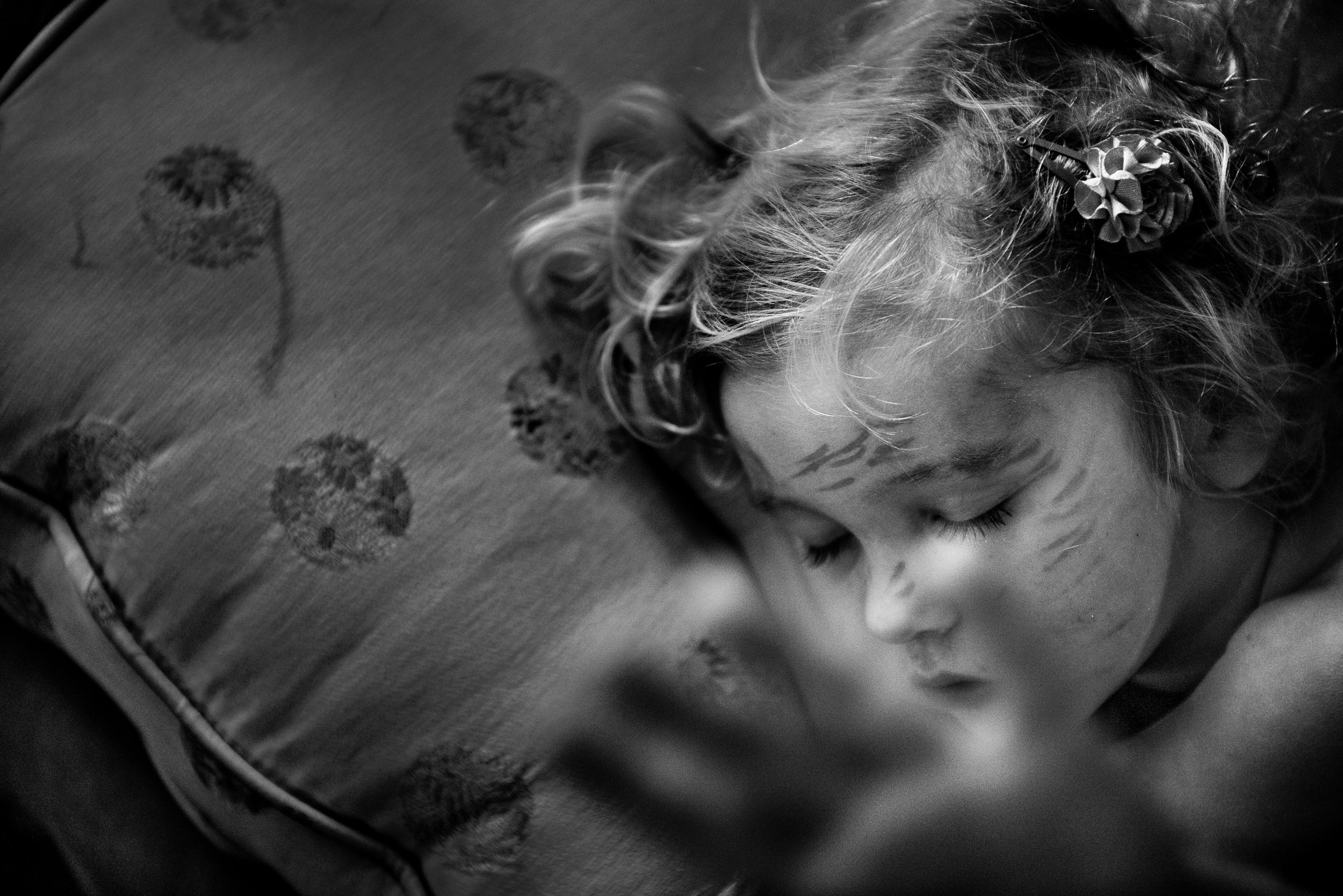 Blog - The Pen & Camera - Gratitude Journal, Inspirational, Writing, Motherhood, Yard-saling, Ukraine, Denver, Colorado - Molly Rees Photo - Black and White Documentary Childhood Photography - sleeping girl with maker on face by M. Menschel