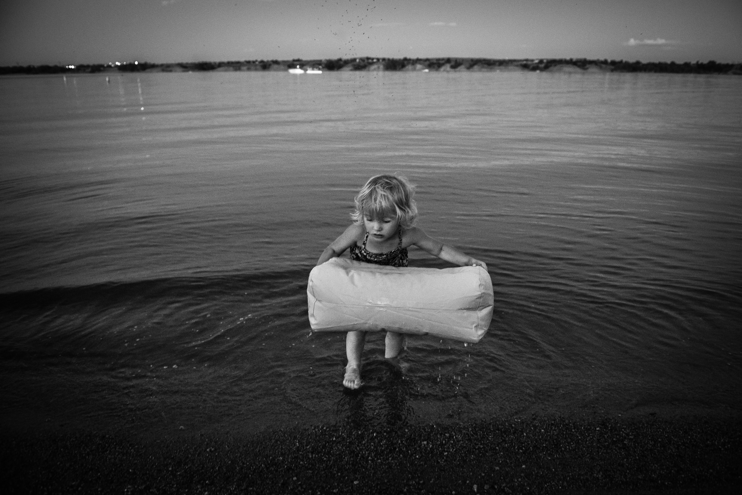 Blog - The Pen & Camera - Molly Rees Photo - Black and White Documentary Childhood Photography - girl at night in water at Chatfield Reservoir in Denver, Colorado by M. Menschel