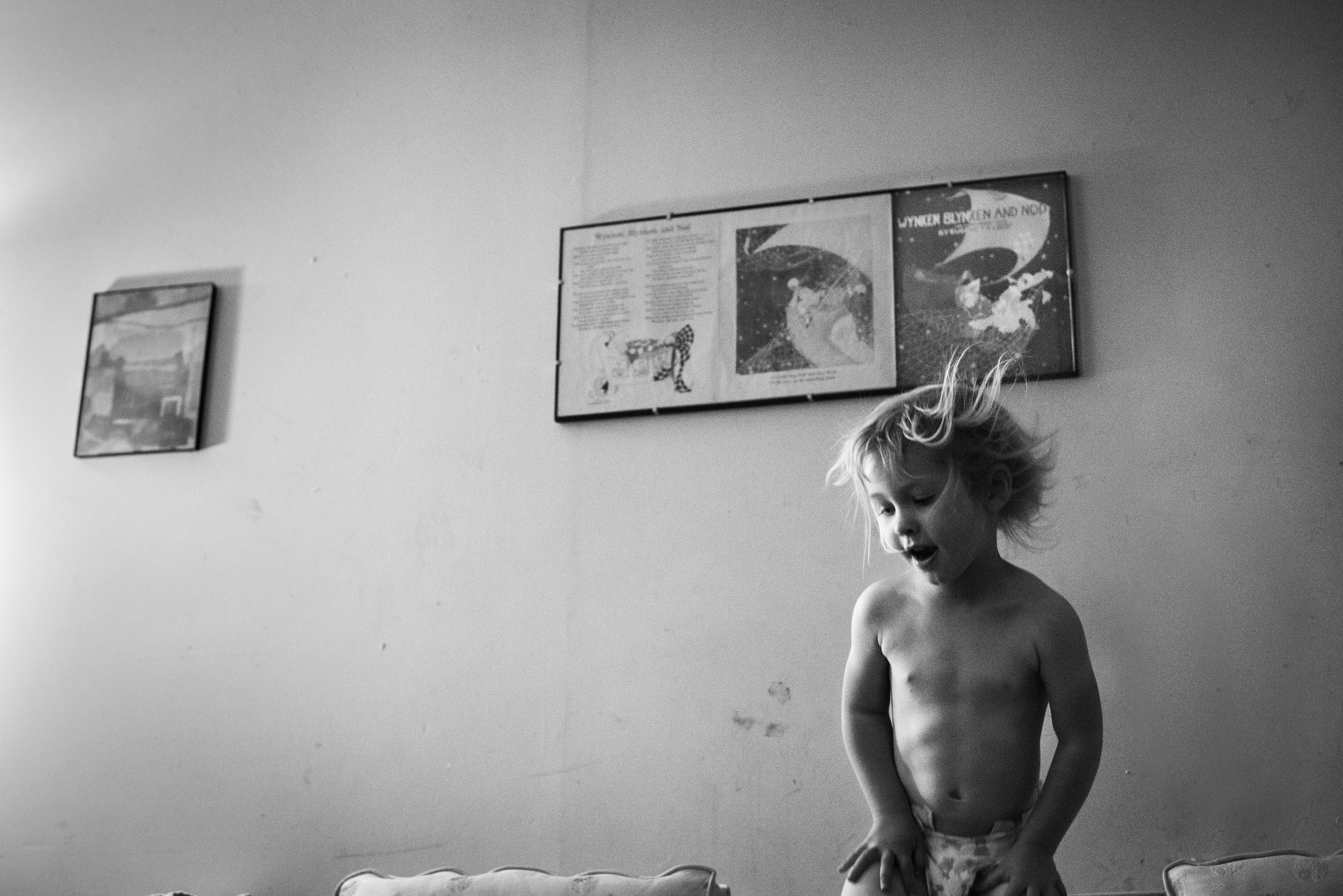 "Blog - The Pen & Camera - Inspirational, Poetry, Spirituality, Writing, Denver, Colorado -  Molly Rees Photo - Black and White Documentary Childhood Photography - girl jumping on couch by M. Menschel ""On Children,"" poem by Khalil Gibran"