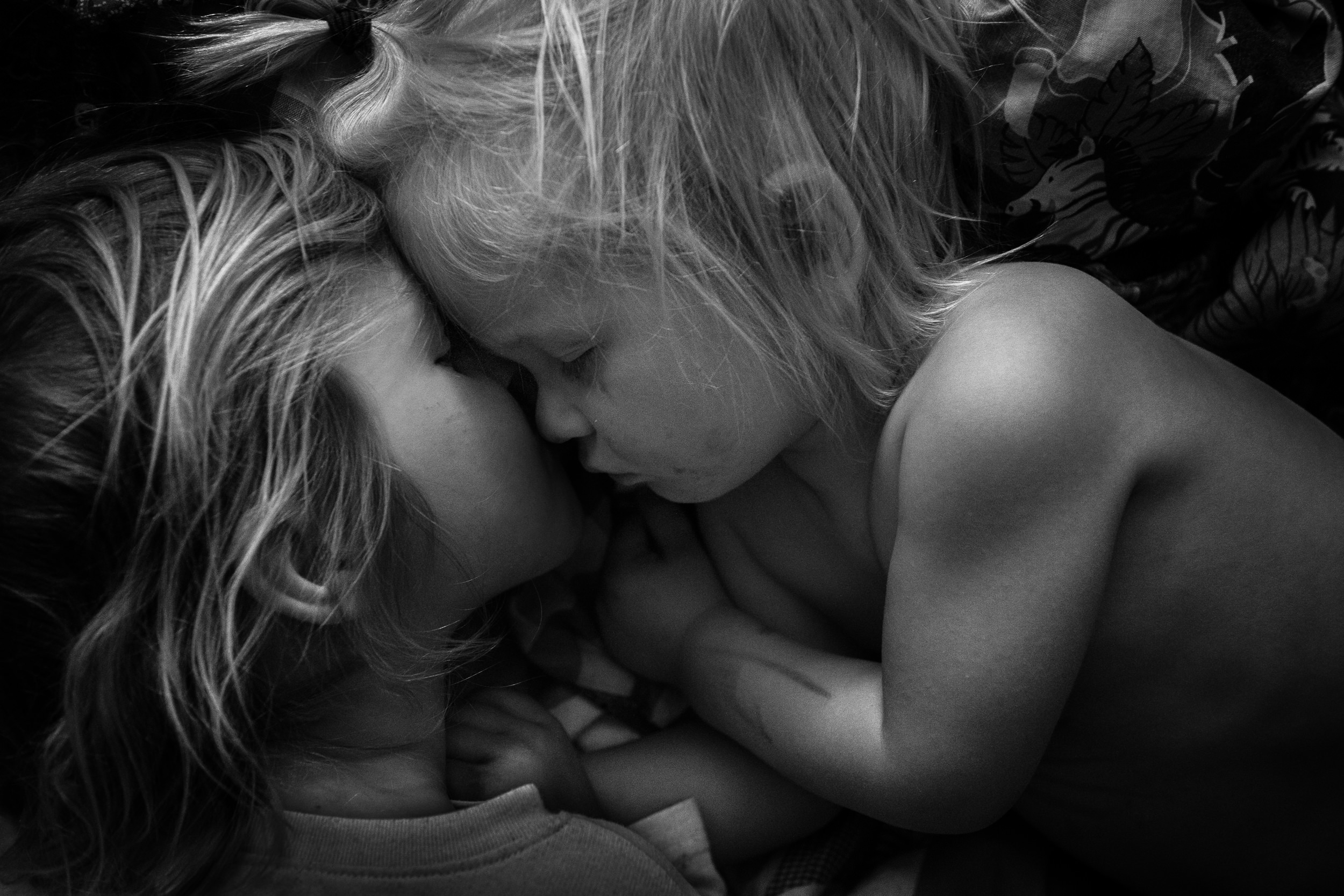 Molly Rees Photo - Black and White Documentary Childhood Photography - Sibling portrait of children sleeping by M. Menschel