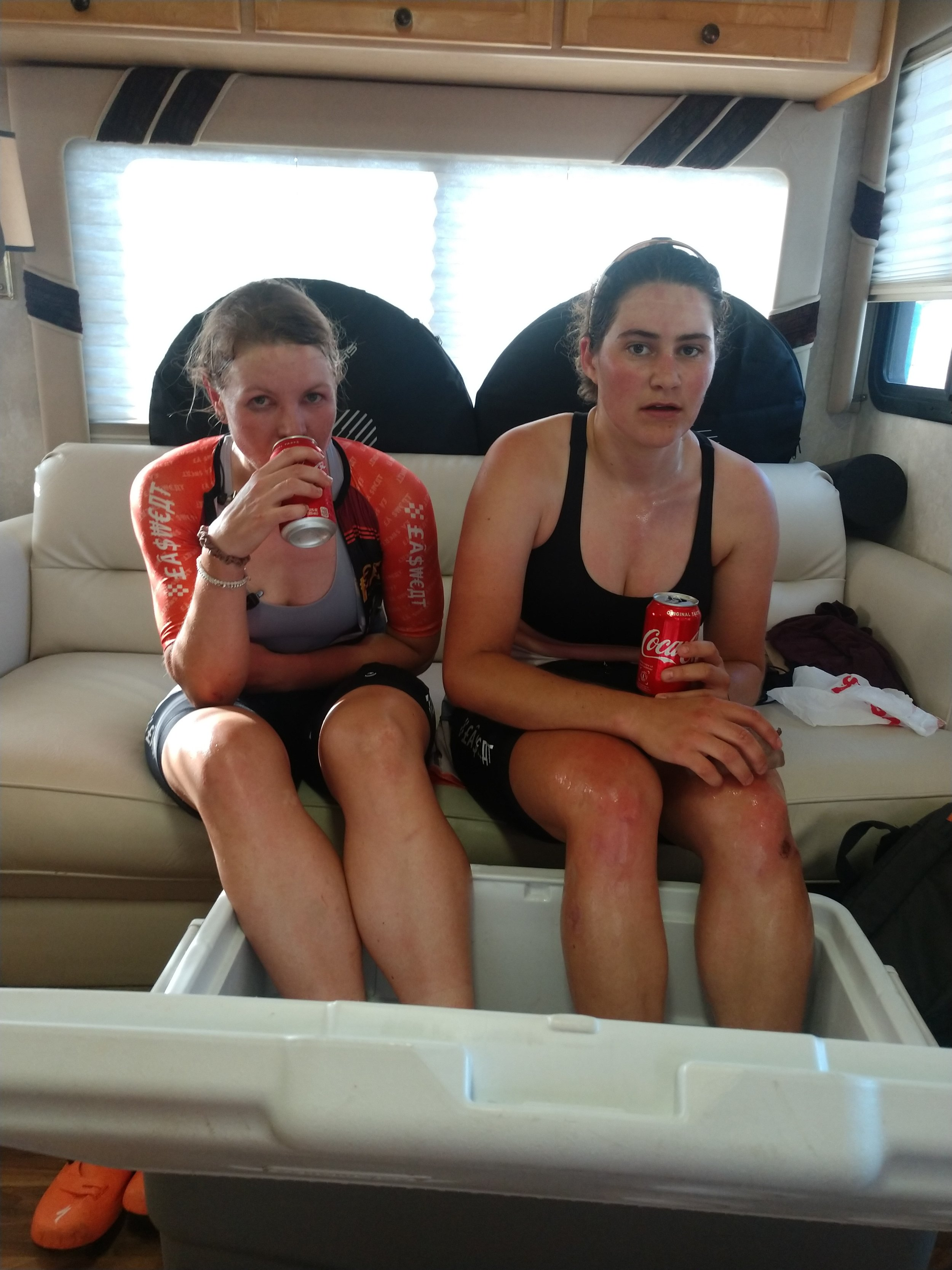 Sarah and Dani enjoying an ice bath and coke after surviving Cry Baby Hill!