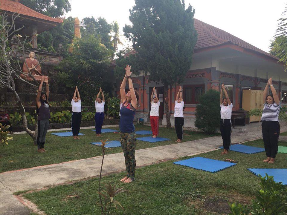 Volunteer Yoga Teacher Jill leading Surya Namaskar
