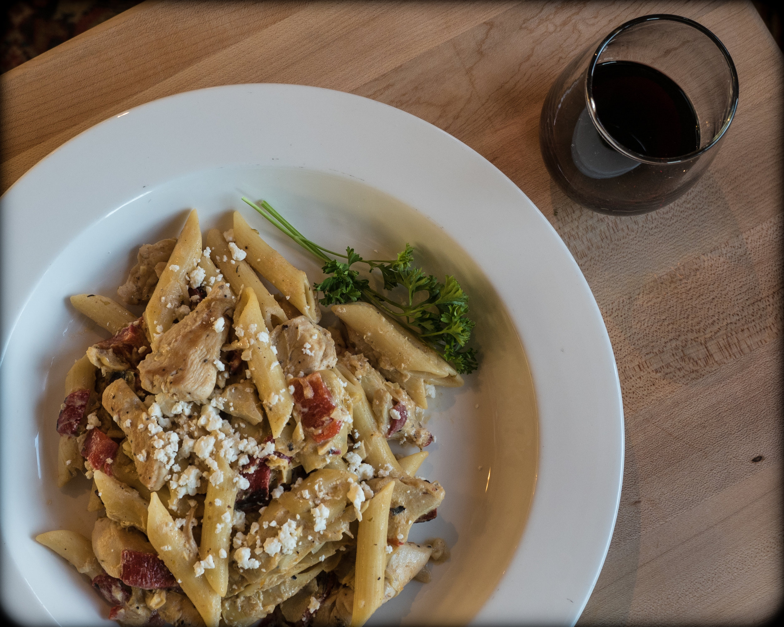 Chicken Penne with artichoke hearts, roasted red peppers, and goat cheese