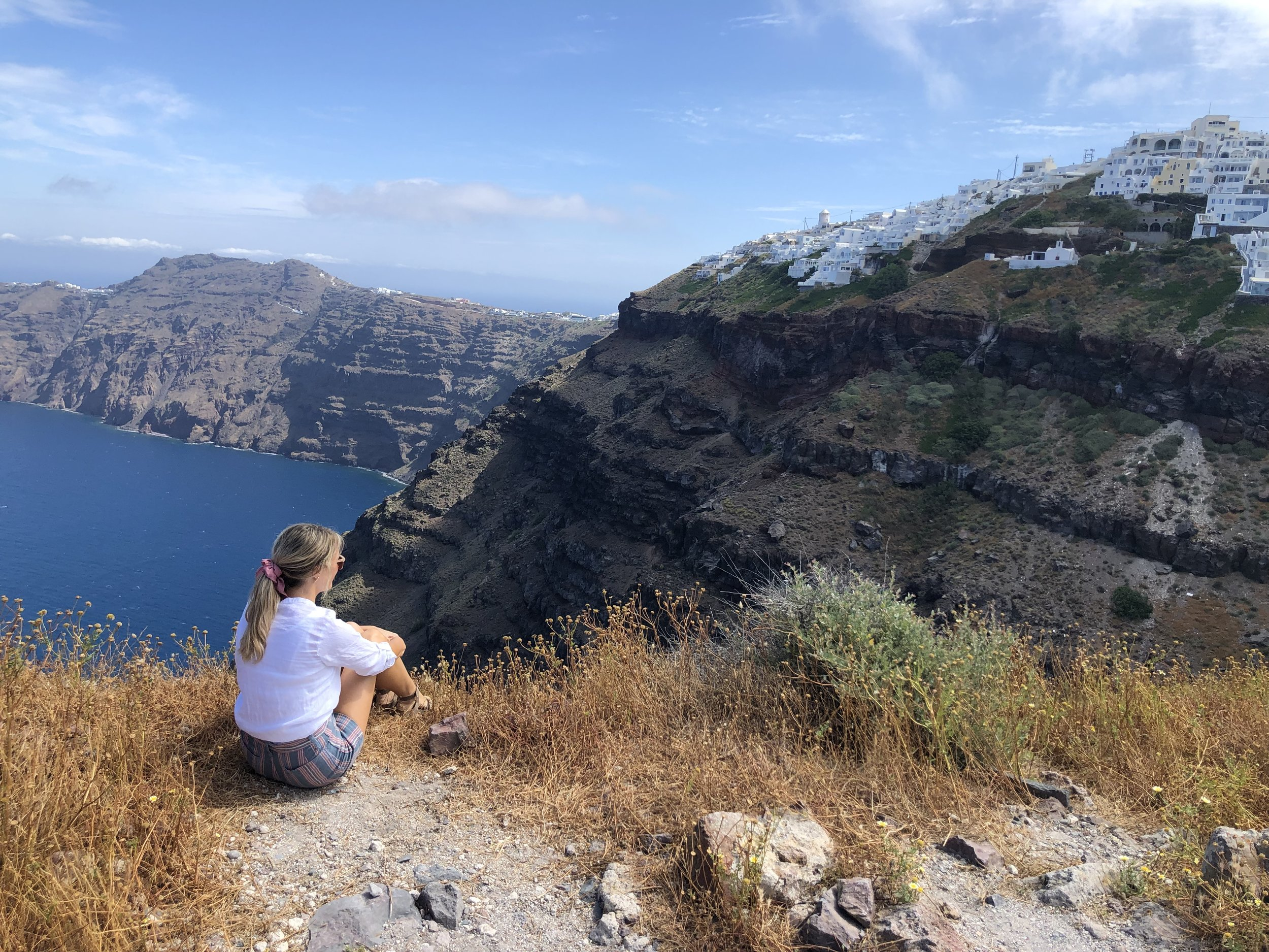 On top of Skaros rock. This is not for littles or people with limited mobility. We had to scale about 15 feet of rock that was at the top of a huge cliff. I'm fairly afraid of heights and it took a lot of self-talk to get me to the top. Worth it, though. The view of Santorini is priceless.