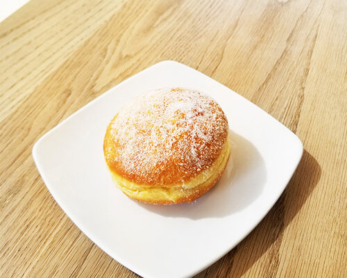 STRAWBERRY FILLED DONUT - $ 1.75