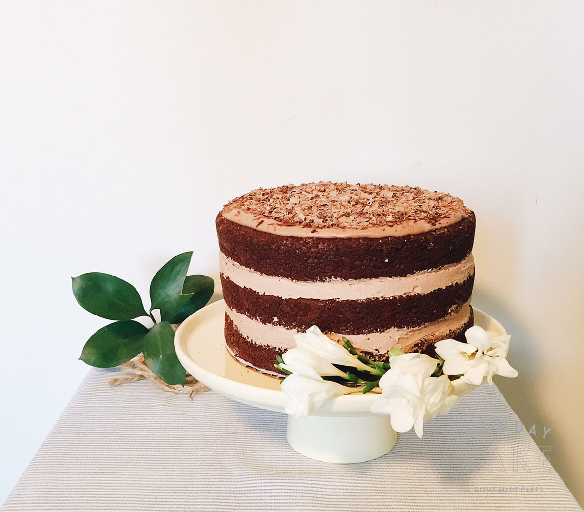 Moist chocolate cake with buttercream chocolate filling, topped with chocolate shavings