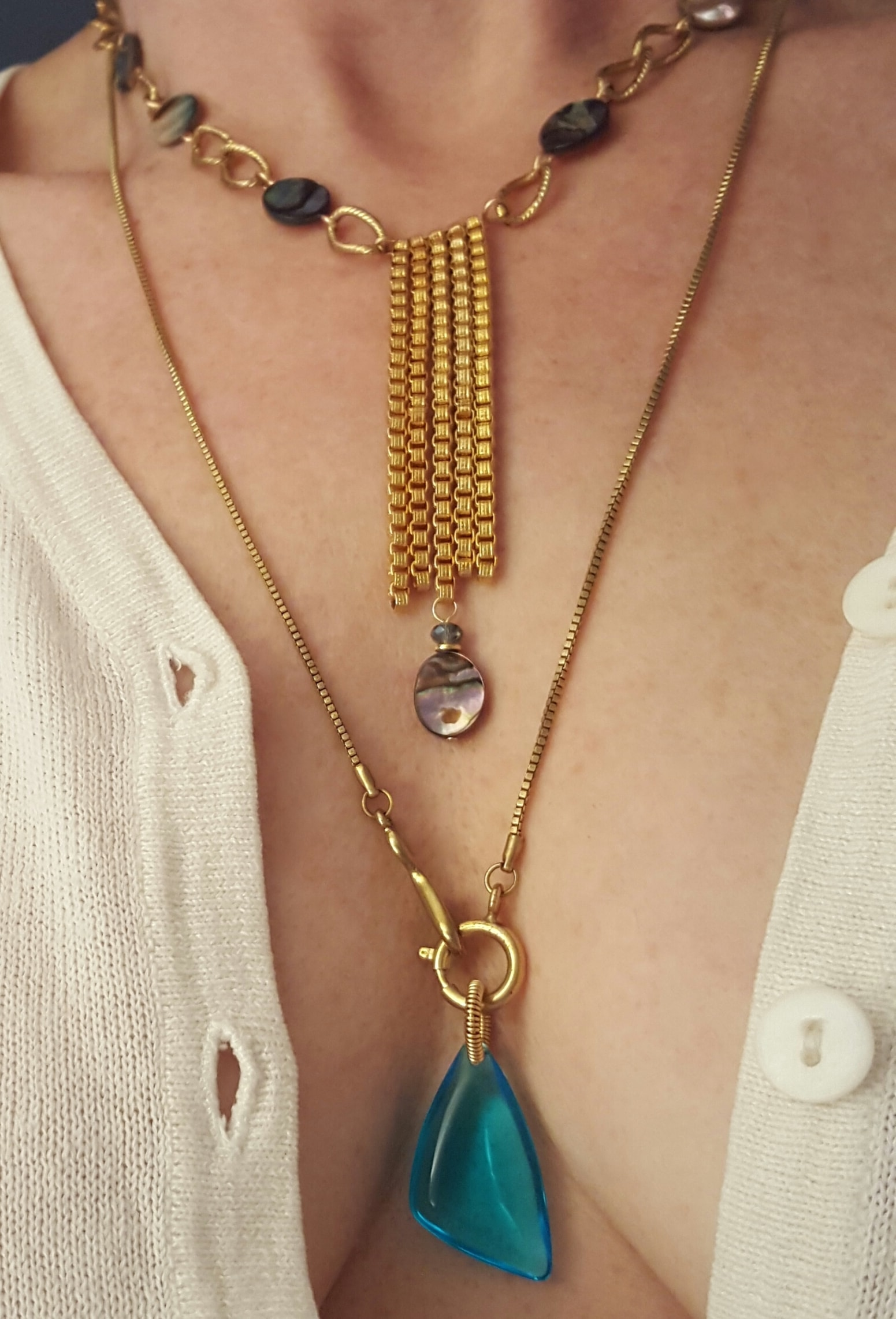 turquoise and gold lariat necklace on model