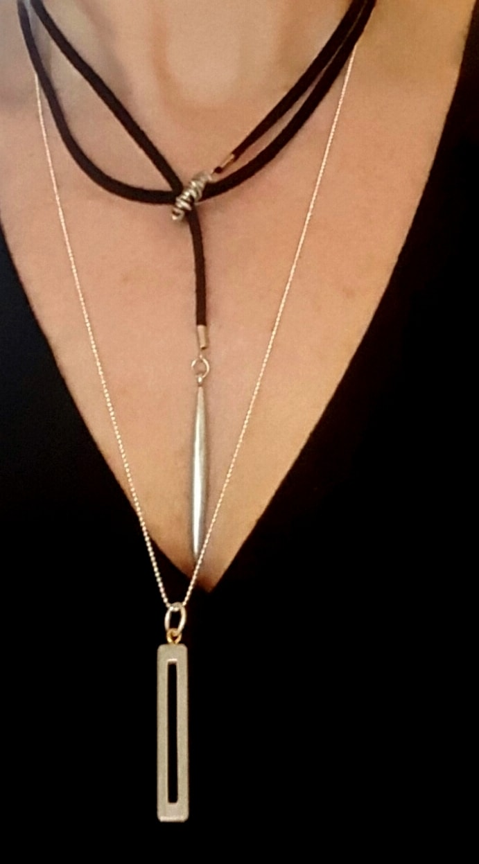 black suede and silver lariat necklace layered with silver column necklace