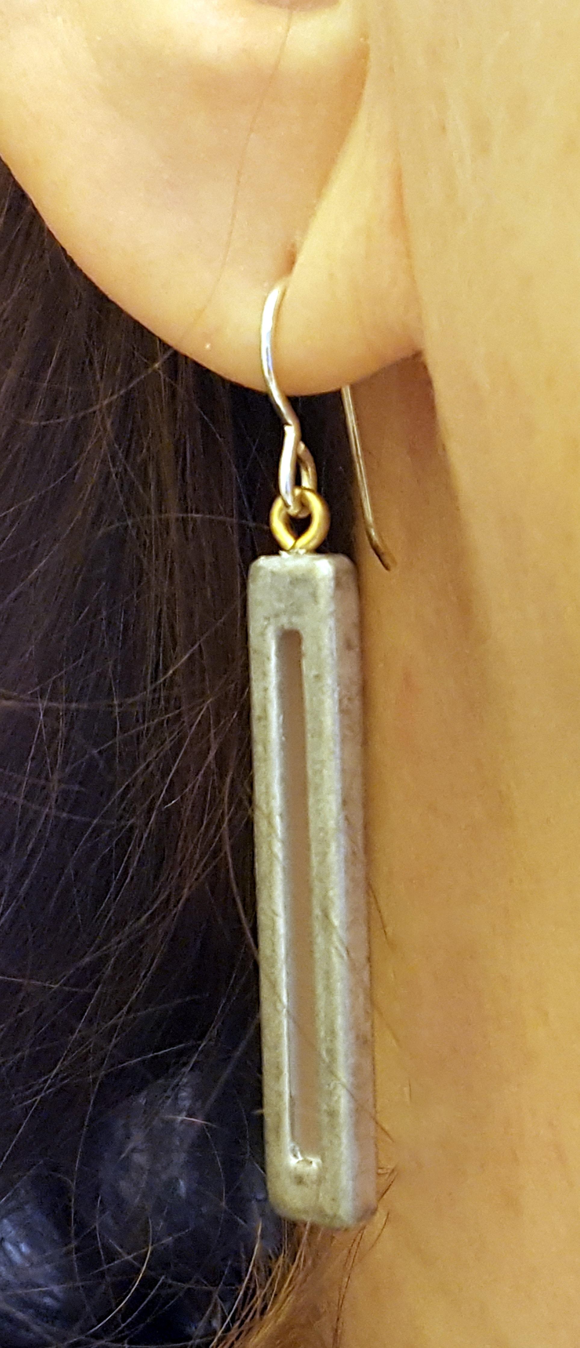Tower of power matte silver earring on model