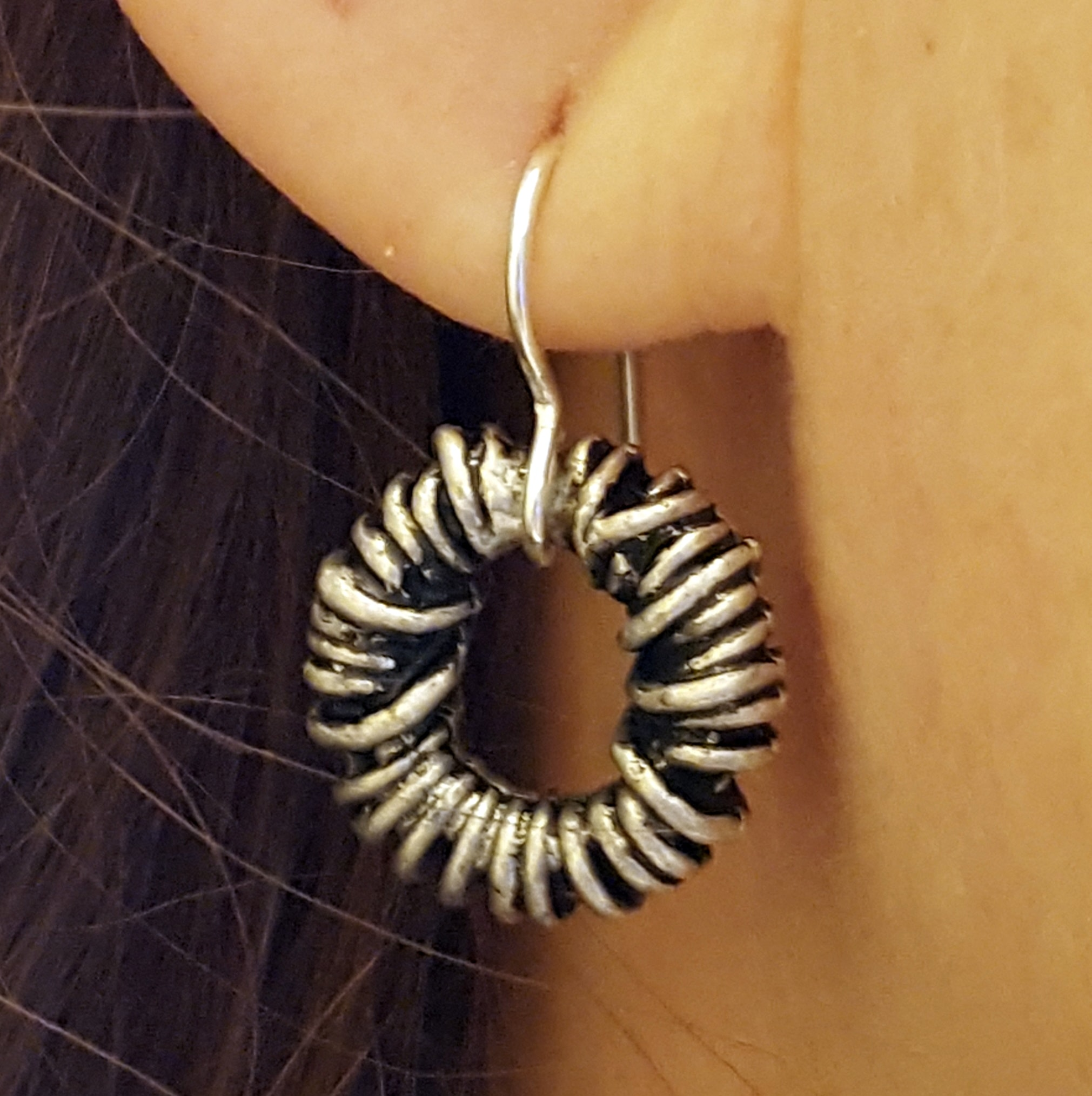 silver twisted earring on model