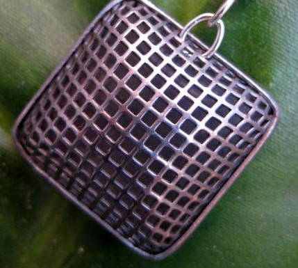 close up of chex silver mesh earring