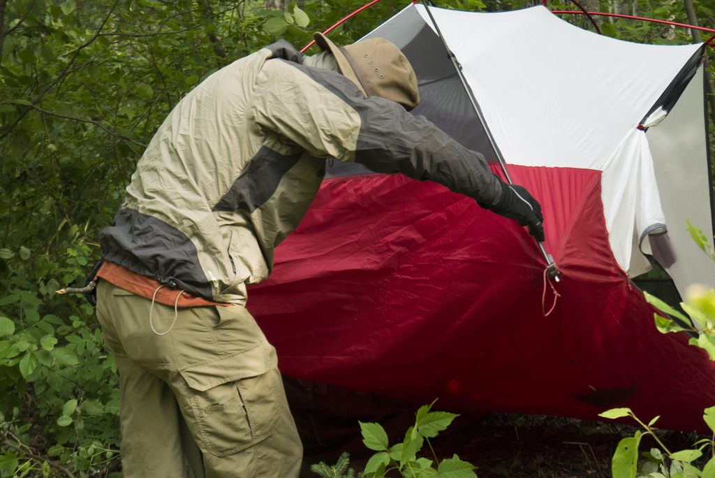 Jason attempting to rid Matt's tent of hornets - much to his frustration.