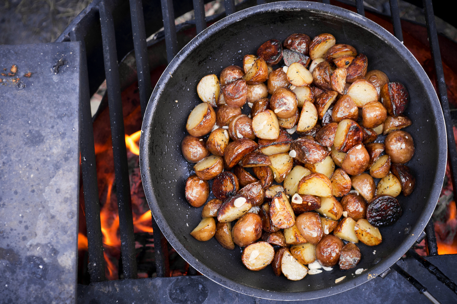 Oh yeah, hear that sizzle—frying potatoes in duck fat collected from a prior roast.