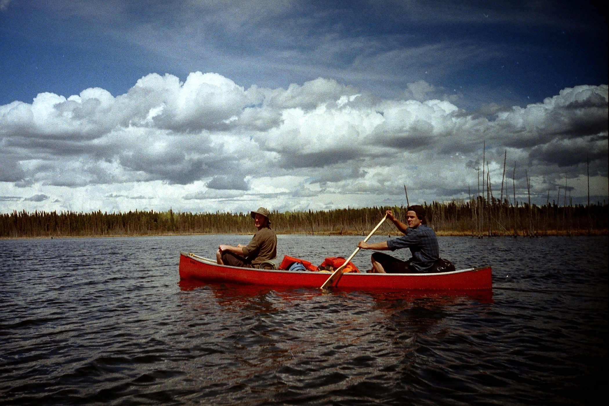 Adam, Jean-Paul (laying down) and Sean paddle through a calm section sheltered by an island. (LOMO LC-A)