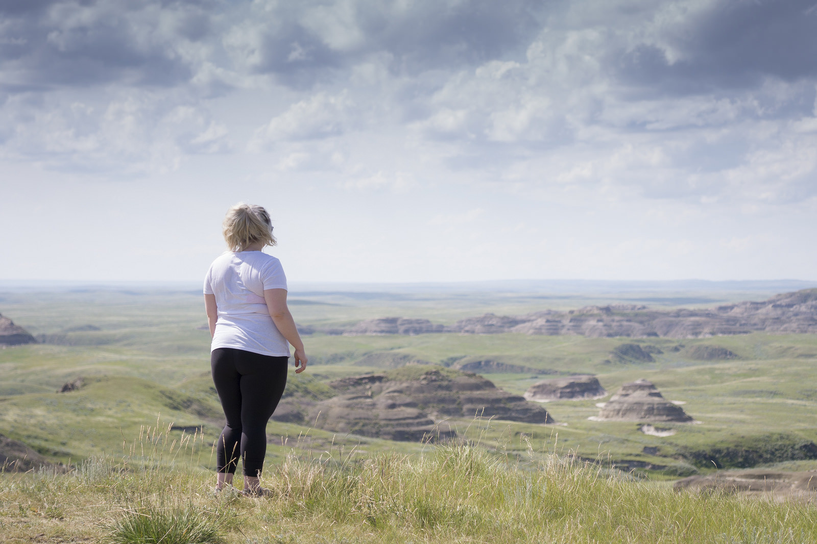 Teisha standing above the Killdeer Badlands from one of the road-accessible viewpoints.