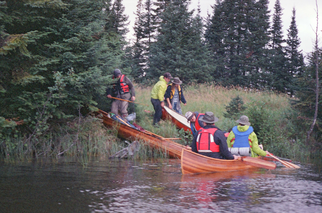 Debarking canoes on a new island. (Hootz)