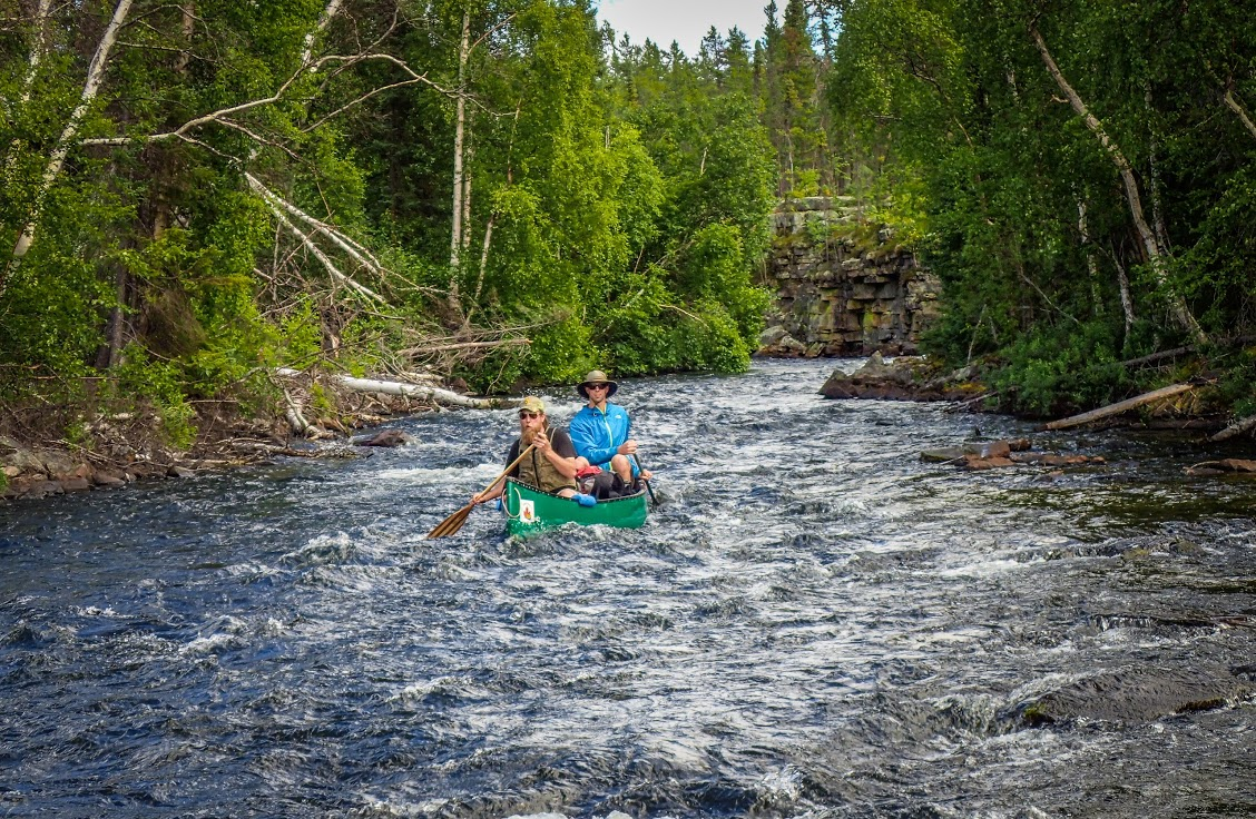 Paddling through a rough river section