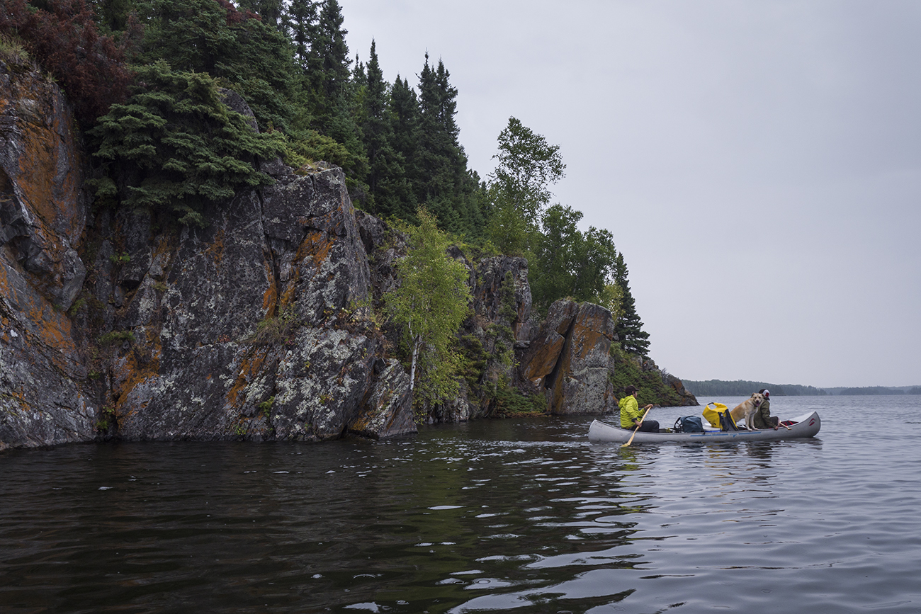 Nate, Oats and Gill paddling by a steep island (Goodson)