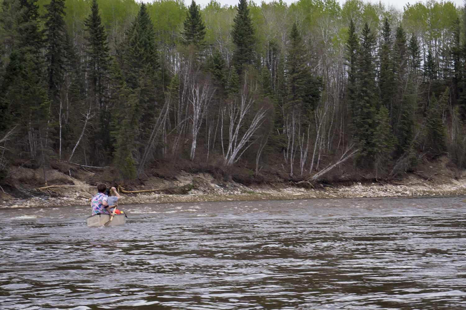 Nate and Gill paddling through rapids sans-lifejacket—which I may have also done but won't recommend (Goodson)