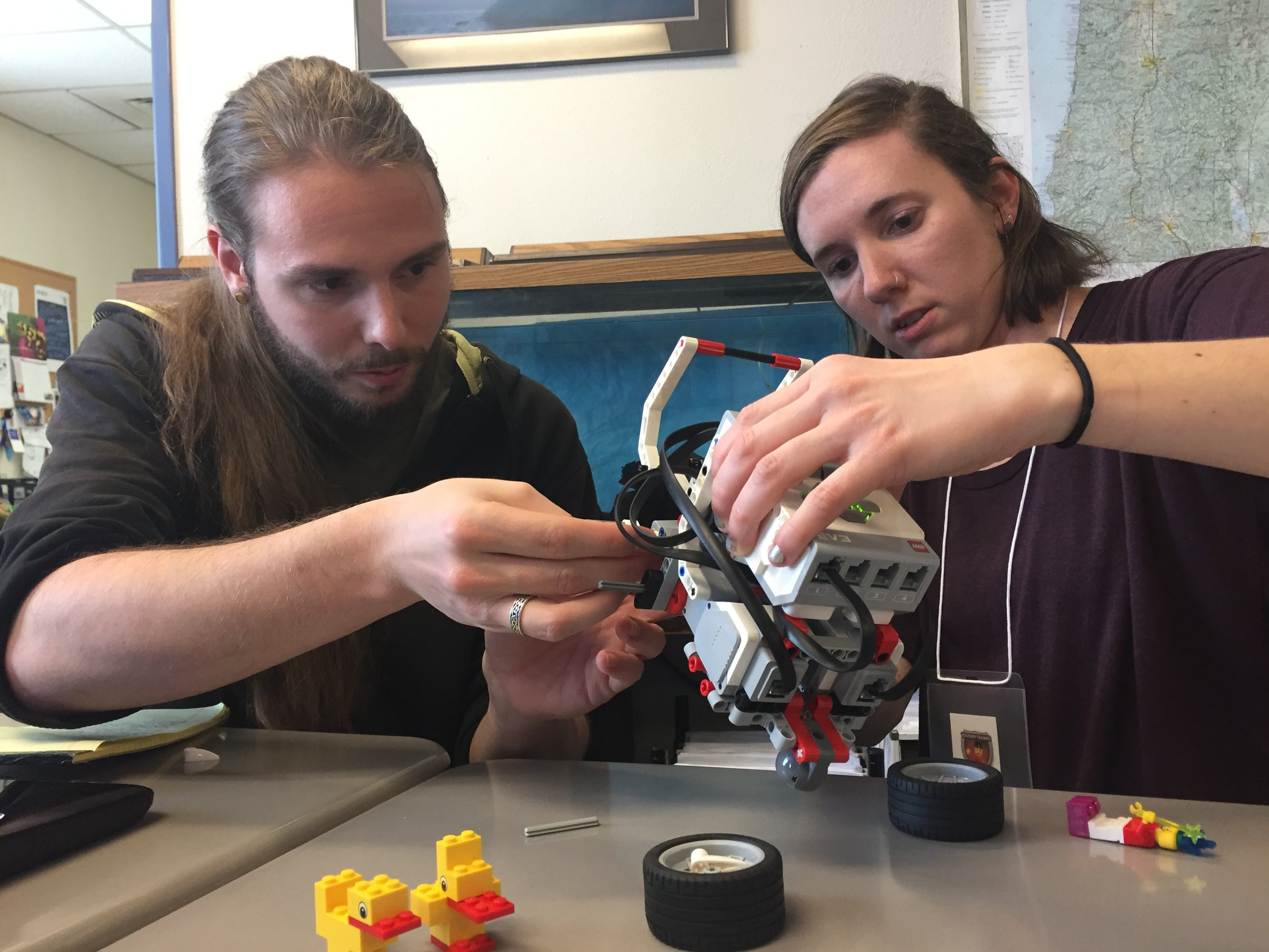Center Point teachers Dillon Hocket (left) and Megan Reynolds learn how to assemble Lego Mindstorms robotic education tools.