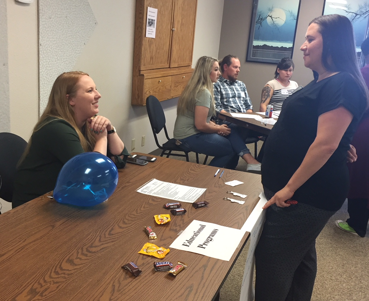 Riverfront School's Brianna Vincent talks with a job fair attendee at the 2018 Looking Glass job fair held at the Administrative offices on Thursday, June 7, 2018.