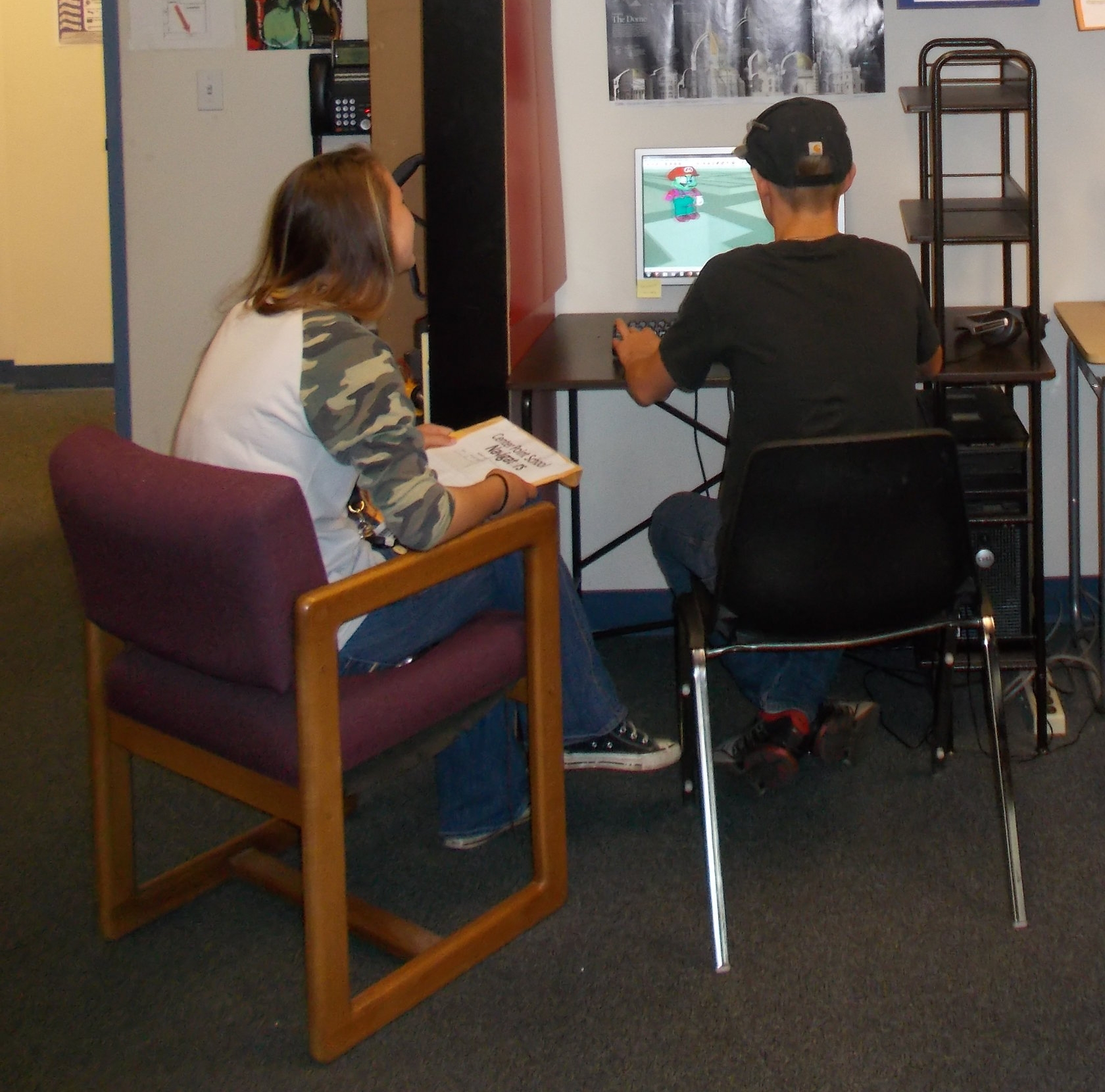 A Center Point student demonstrates his computer skills to a visitor