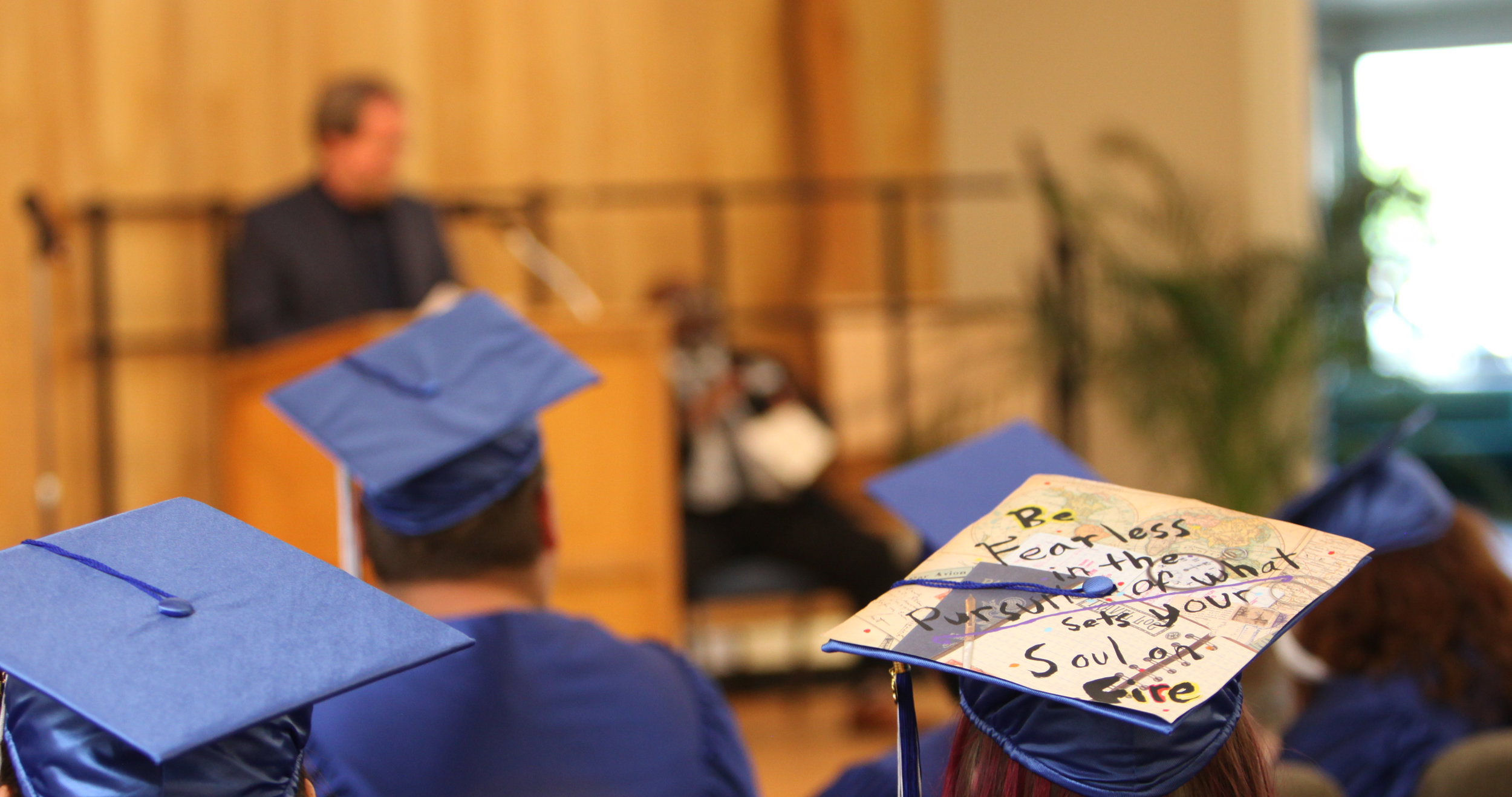 "Atop a graduation cap of one of the Looking Glass Riverfront alternative school graduates is written ""Be fearless in the pursuit of what sets your soul on fire."""