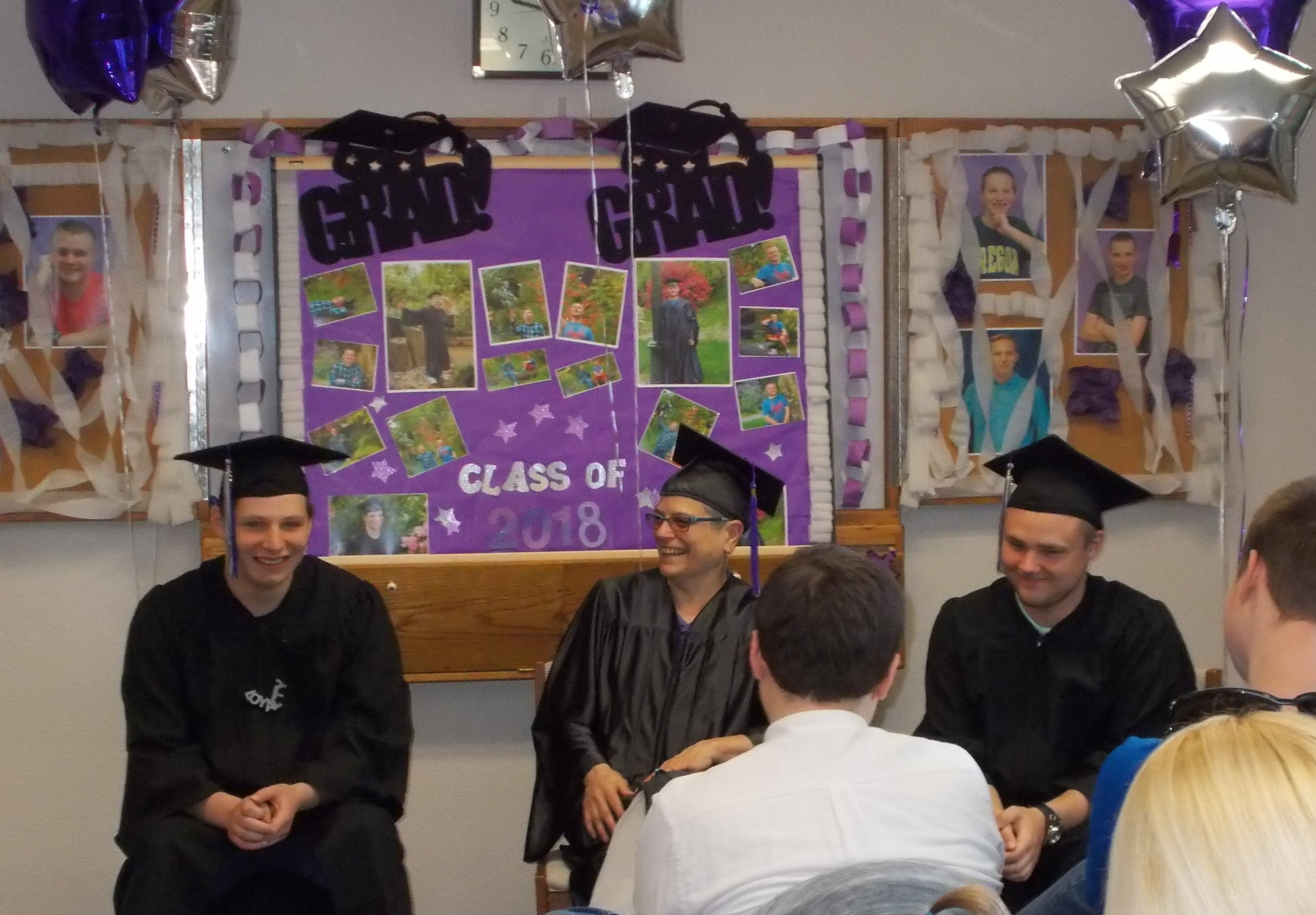Center Point Director Lynda Whitener, sits with her two program graduates during the ceremony, which included moments of laughter and tears.
