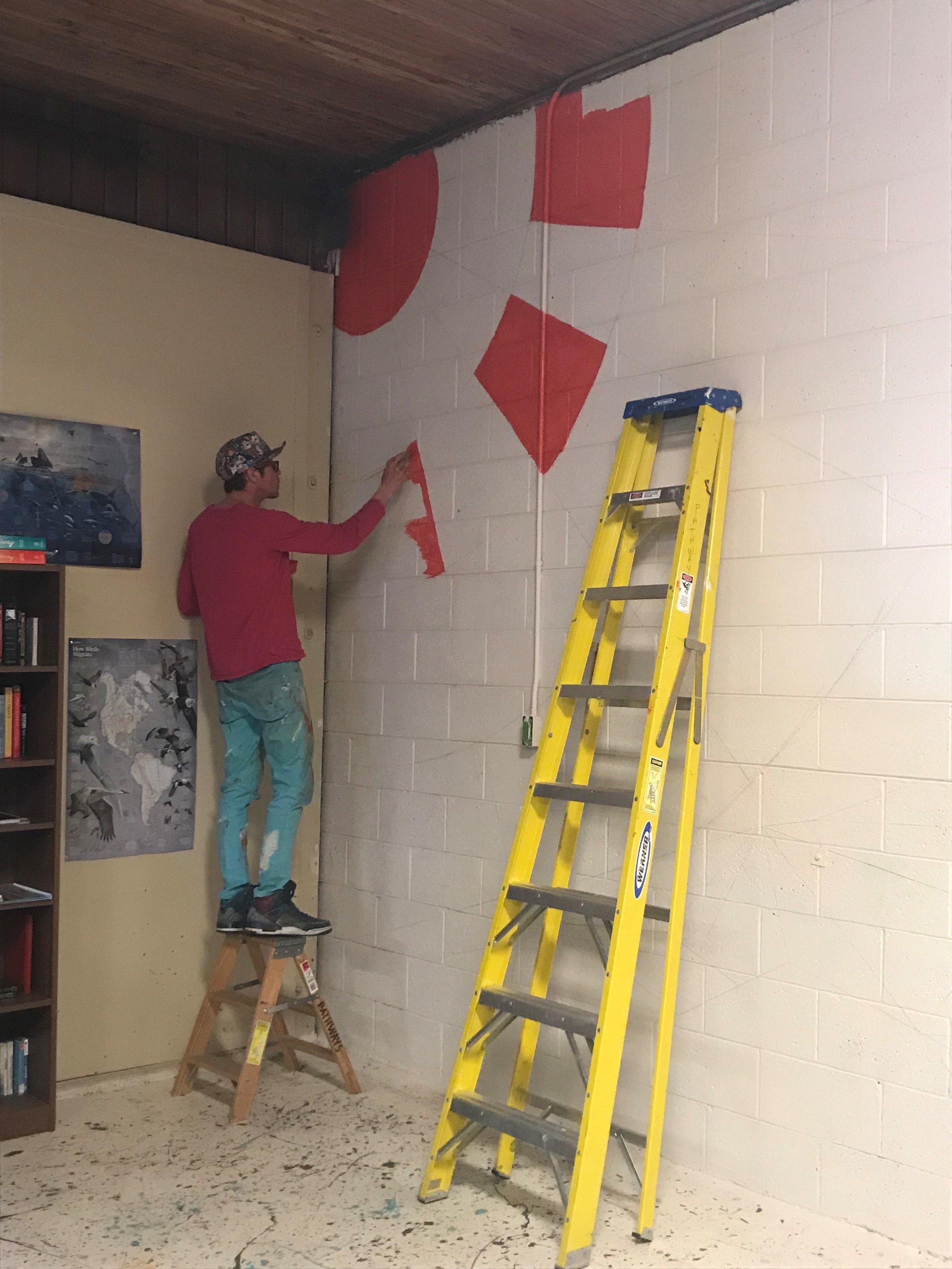 Wayde Love beginning the mural