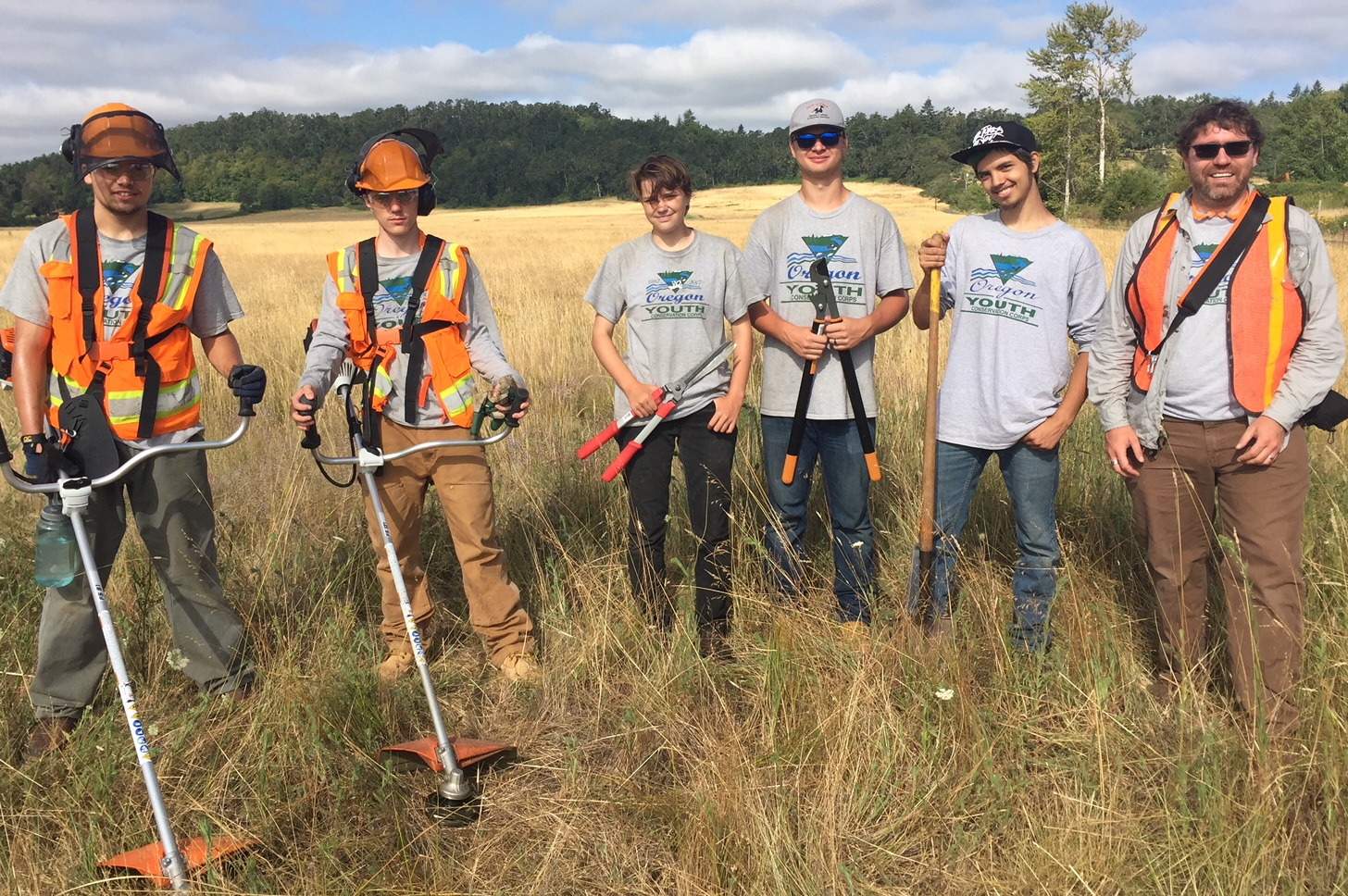 Crew supervisor, Craig Annsa (far right) oversees a work crew of 5 on assignment for the BLM to remove invasive species in a field off Greenhill Road in West Eugene.