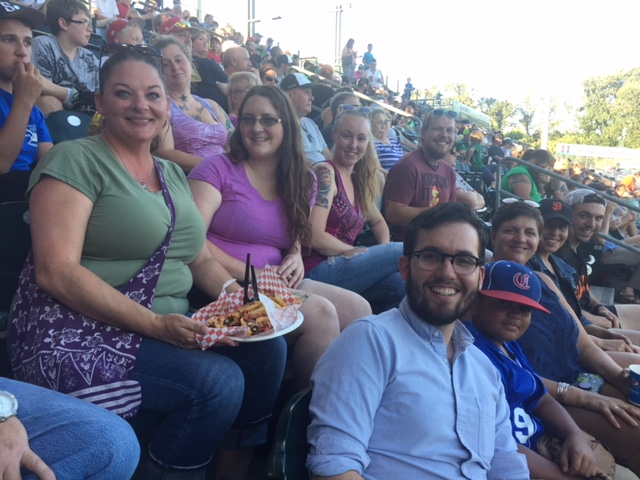 Looking Glass staffers take a break from their promotional booth shifts to enjoy a beautiful night at the ball park.