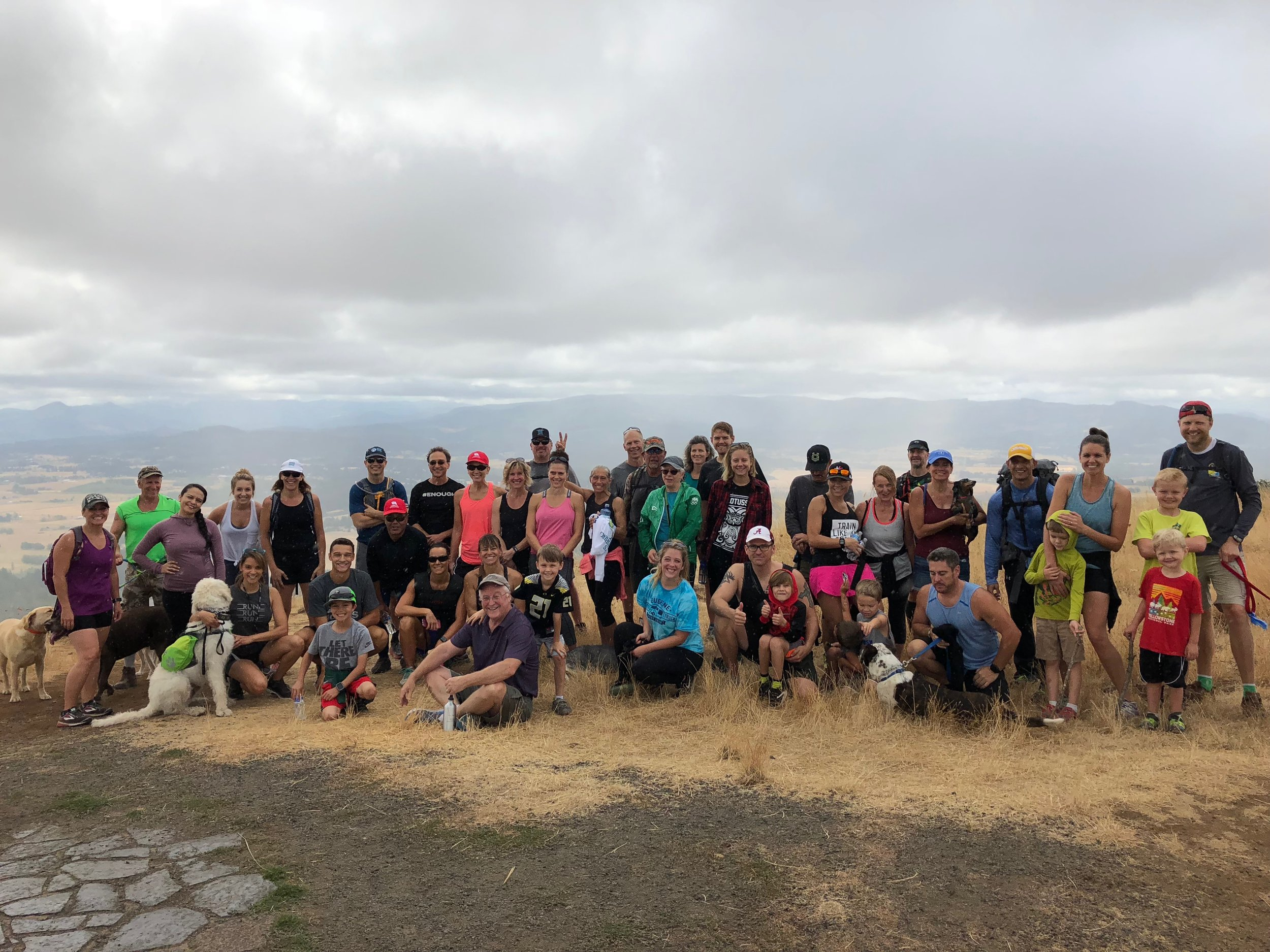 A group of Looking Glass supporters takes a break for a group photo atop the summit at Mount Pisgah during the Looking Glass Hike for Hope fundraiser event on Saturday, August 11th.