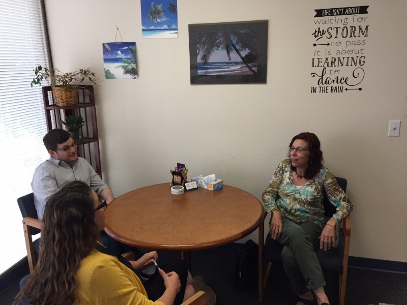 Center Point School Therapist, Ethan Milner (top left) and Family Services Coordinator, Crystal Hall, meet with Angela Larsen (right), a parent of a 3rd year Center Point School student.