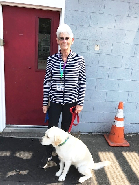 Barbara Lucas with her therapy dog, Tina.