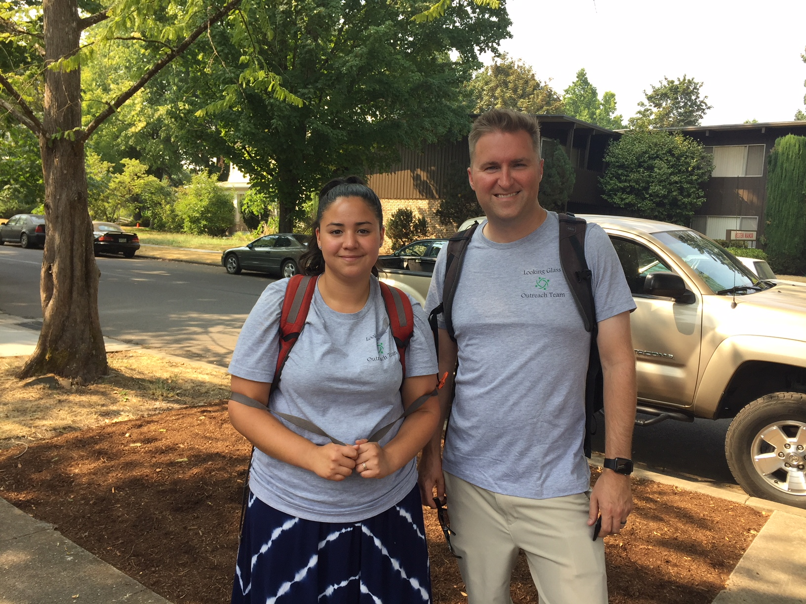 Street Outreach Worker, Rose Reyes (left), and Marketing & Development Director, Tyler Mack (right), on a recent outing providing water, snacks, socks and other resources to street youth in Eugene.