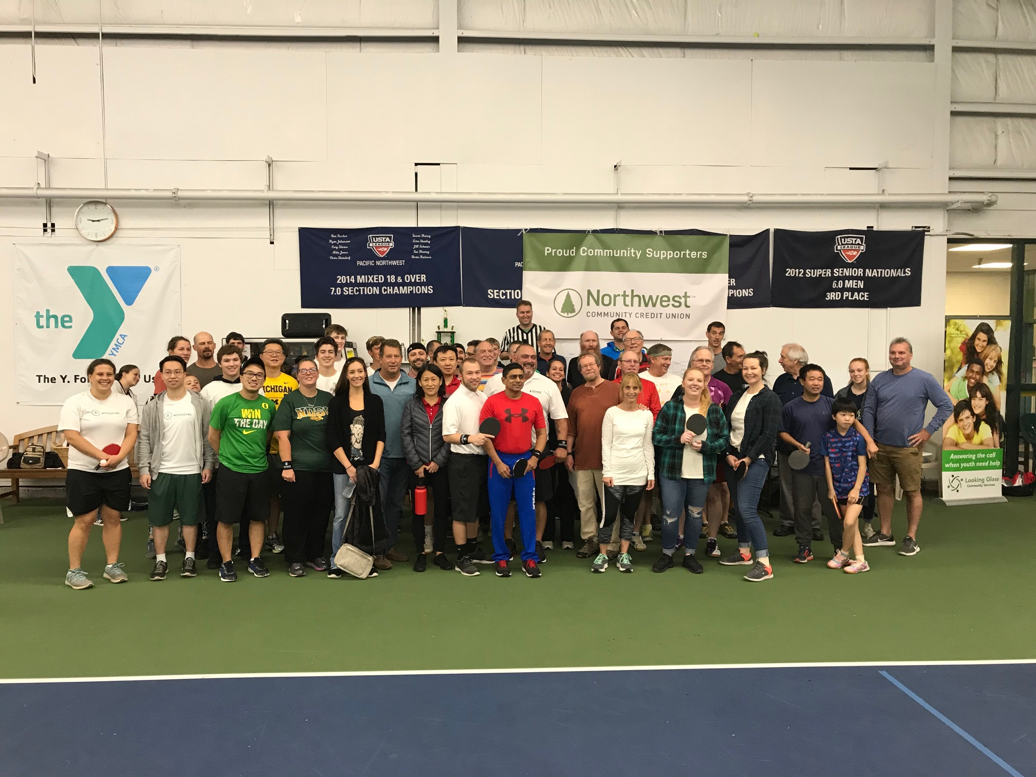Players from 25 competing doubles teams posed for a group photo before competition began at the Paddle Battle 2018 ping pong tournament event, Saturday, Oct 6th at the Eugene YMCA.