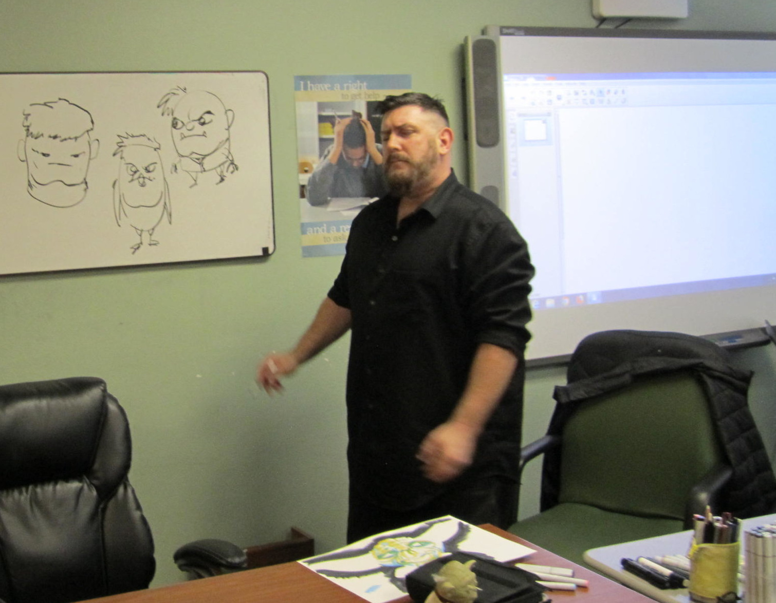 Matt illustrates some of his facial drawing techniques on the white board at Center Point School.