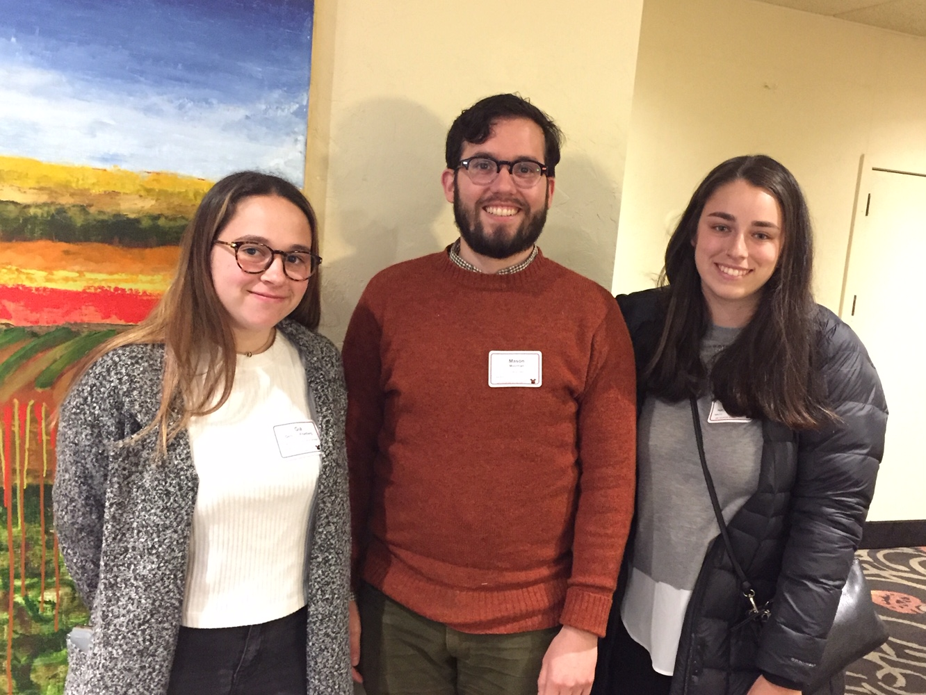 Gia Gershon-Friedberg and Rachel Rozenfeld join Looking Glass Development Coordinator Mason Moorman (center) for a photo after the United Way luncheon.